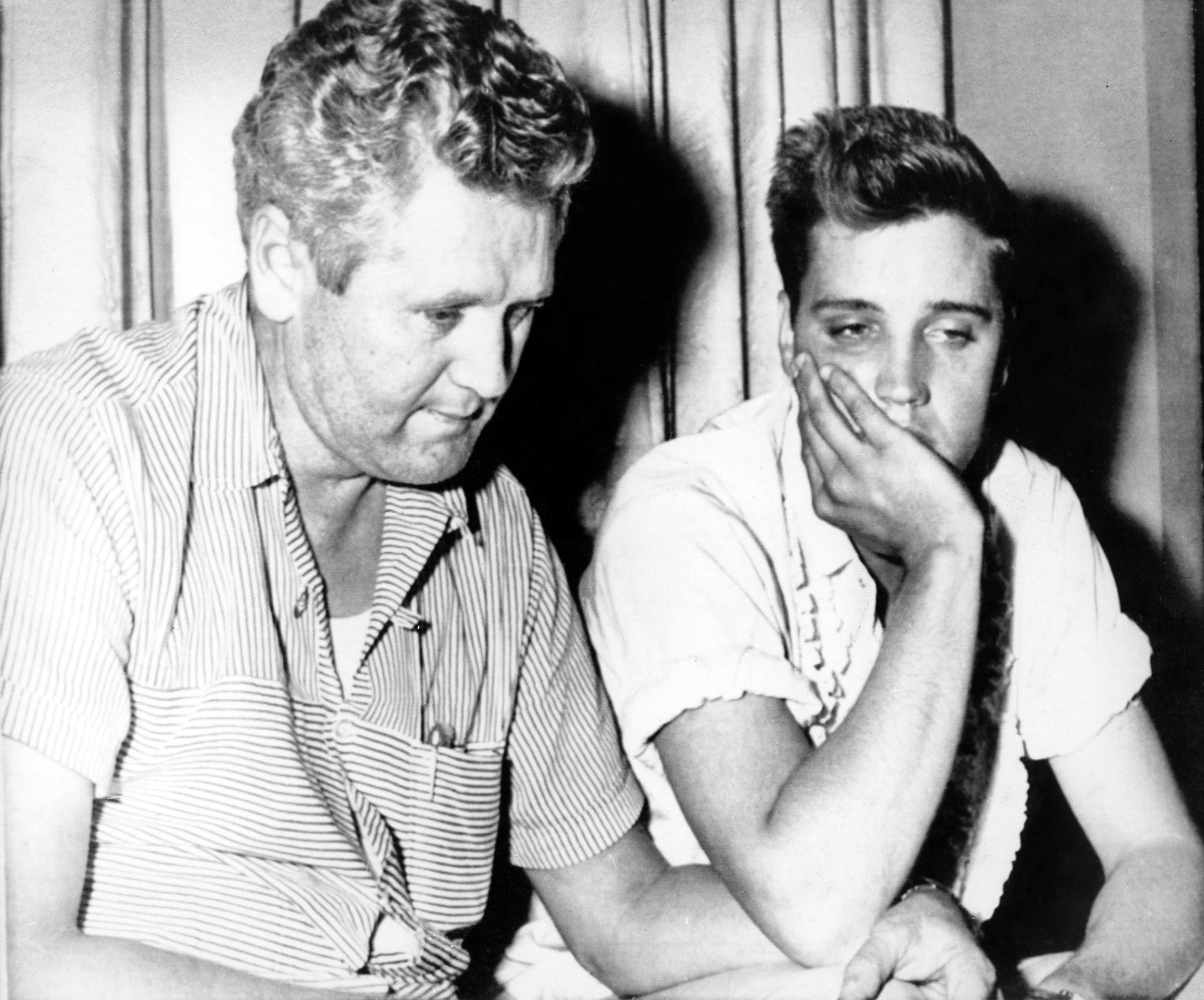 Elvis mourns the death of his mother Gladys with his father at Graceland, Aug. 14, 1958.