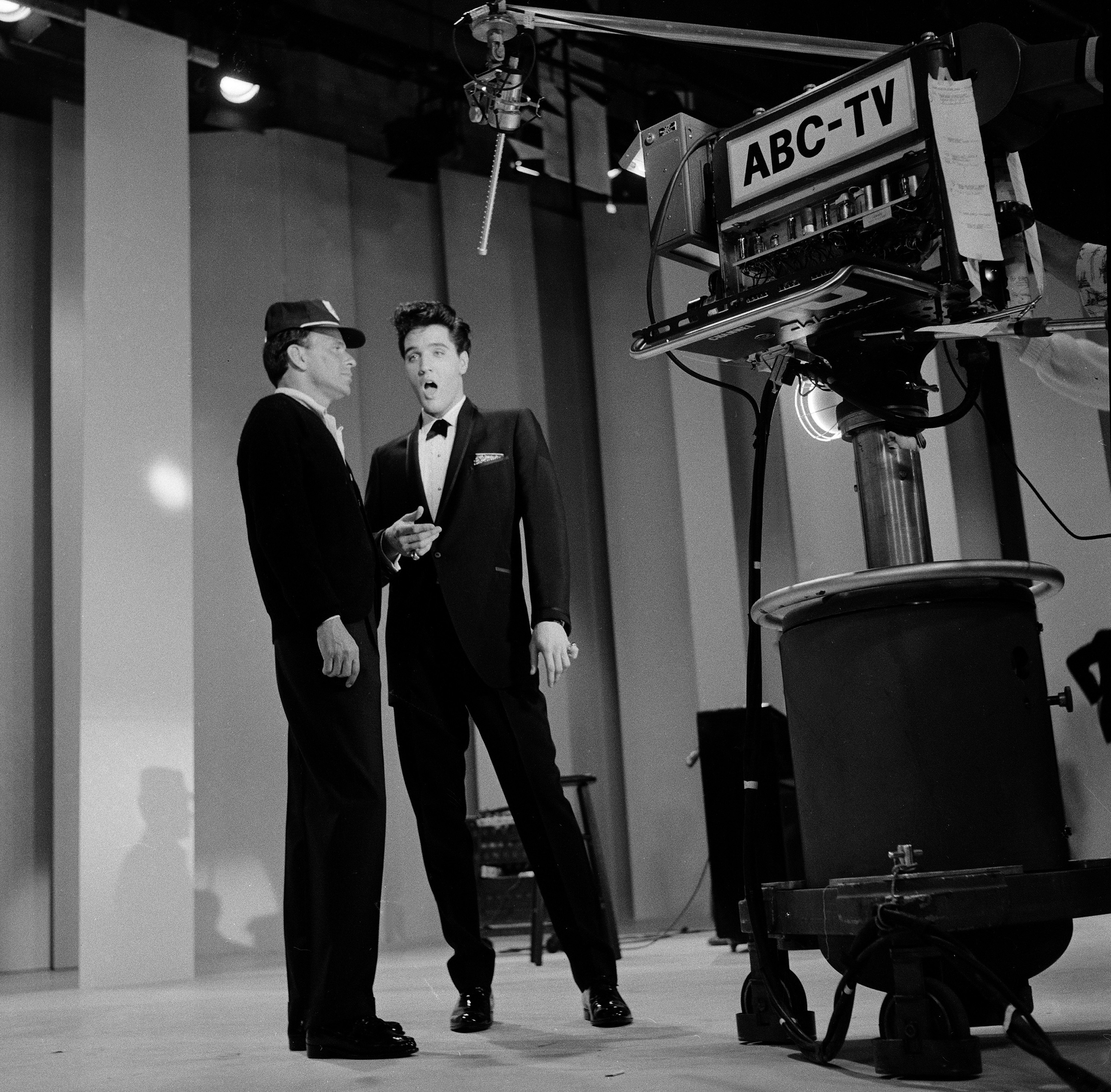 Frank Sinatra (left) welcomed special guest star Elvis Presley home from the Army. A highlight from the show featured a medley by Sinatra and Presley of each other's songs. 1960.