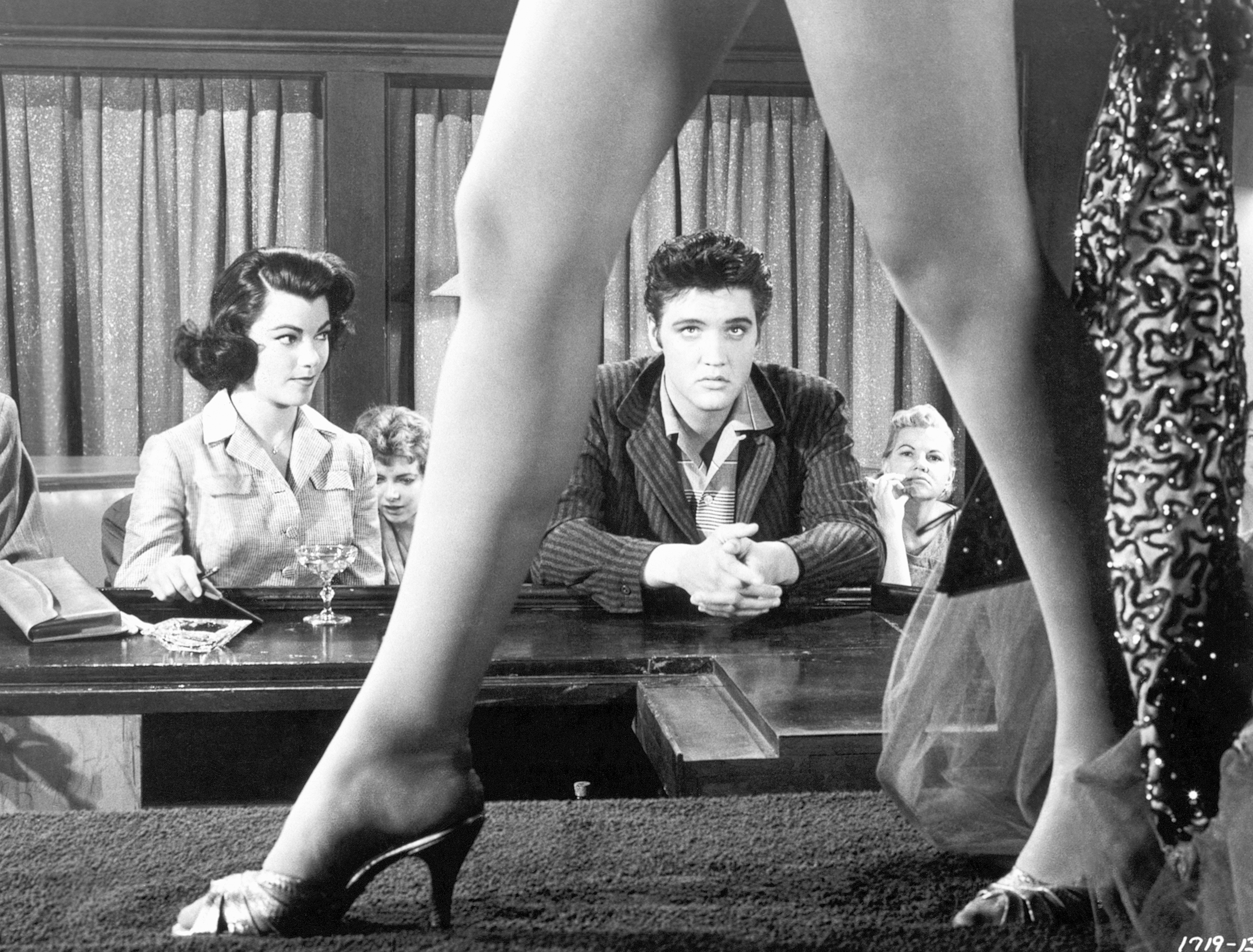 Jailhouse Rock : 1957, Elvis in a scene where he is watching a burlesque dancer with Judy Tyler.