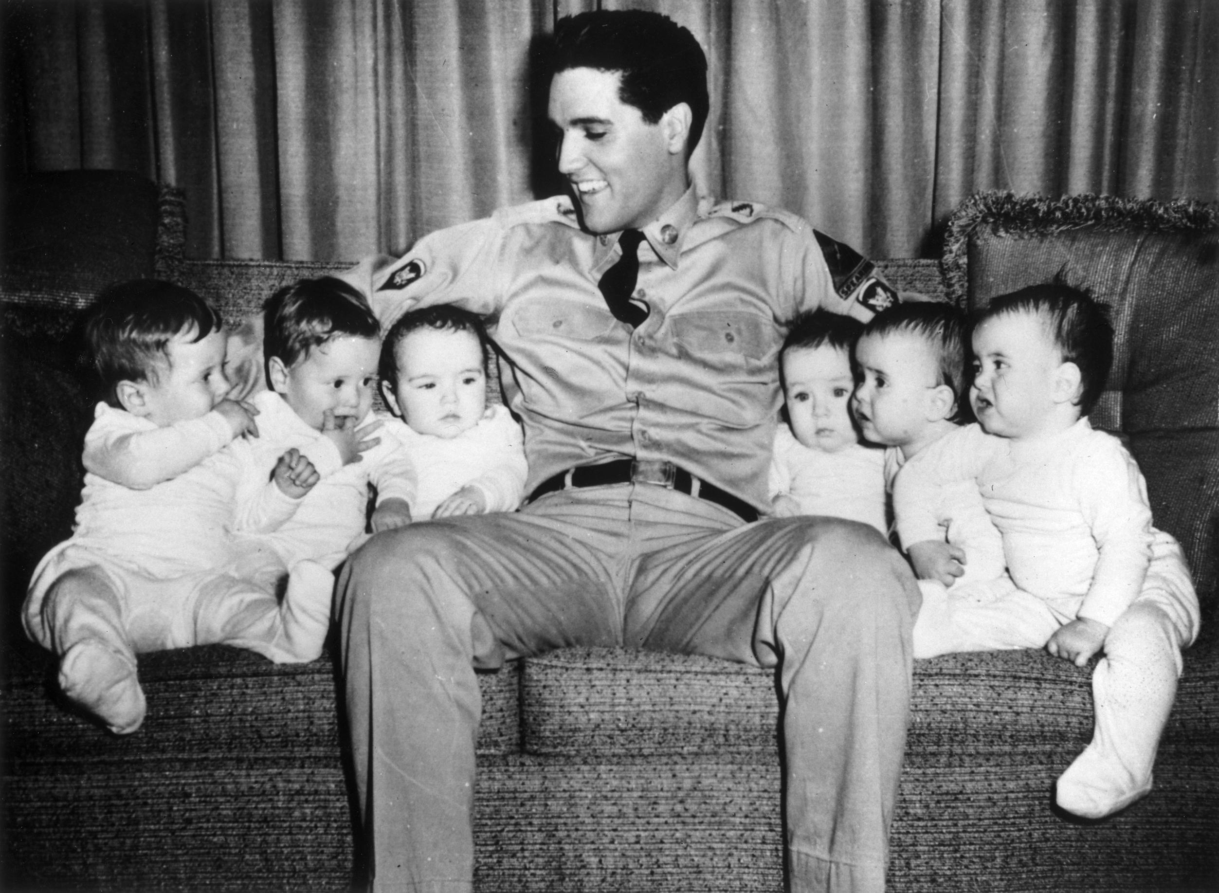 GI Blues : 1960, Elvis on set with six babies (three sets of twins).