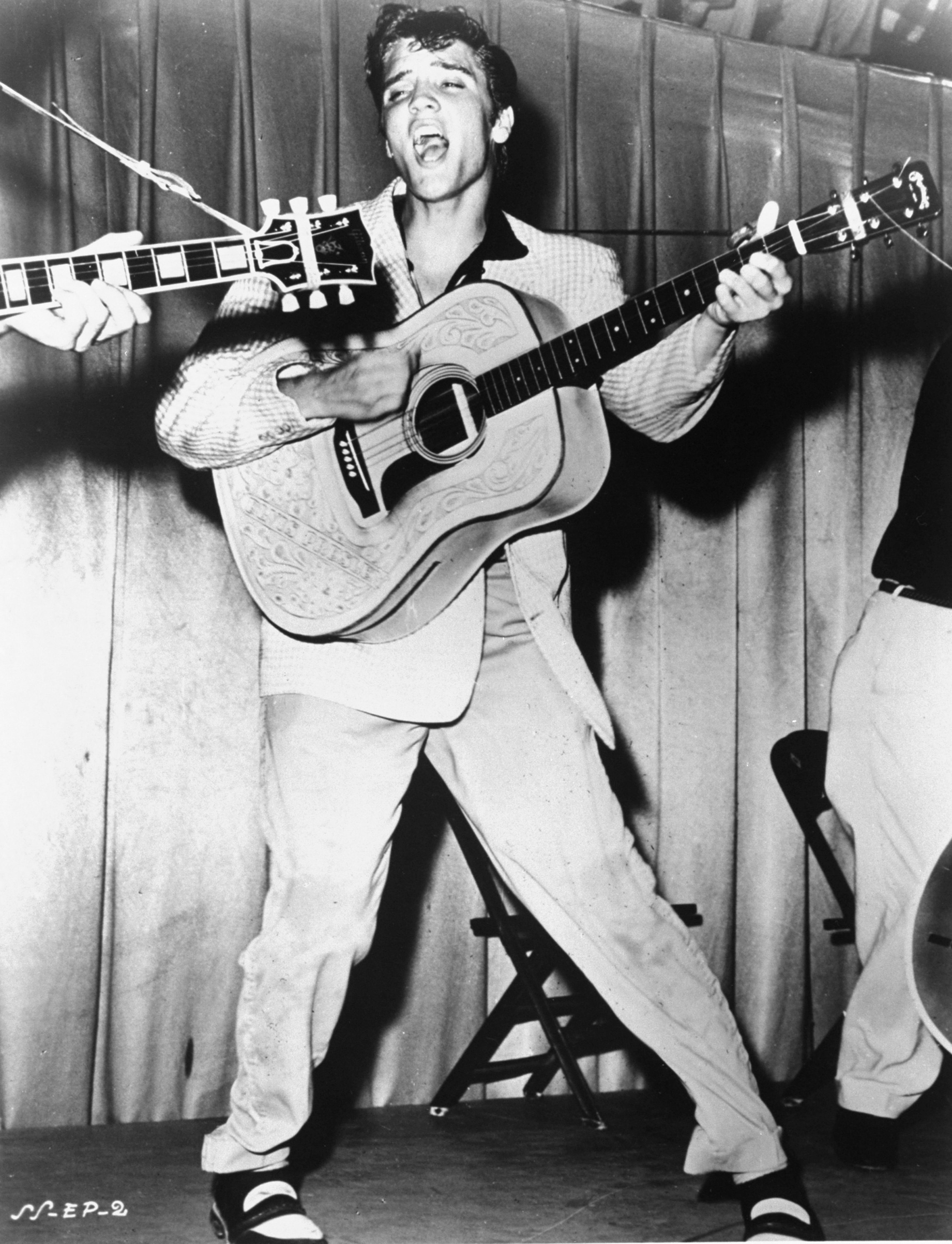 Elvis  performs on the stage in Tampa, Fla, 1955.