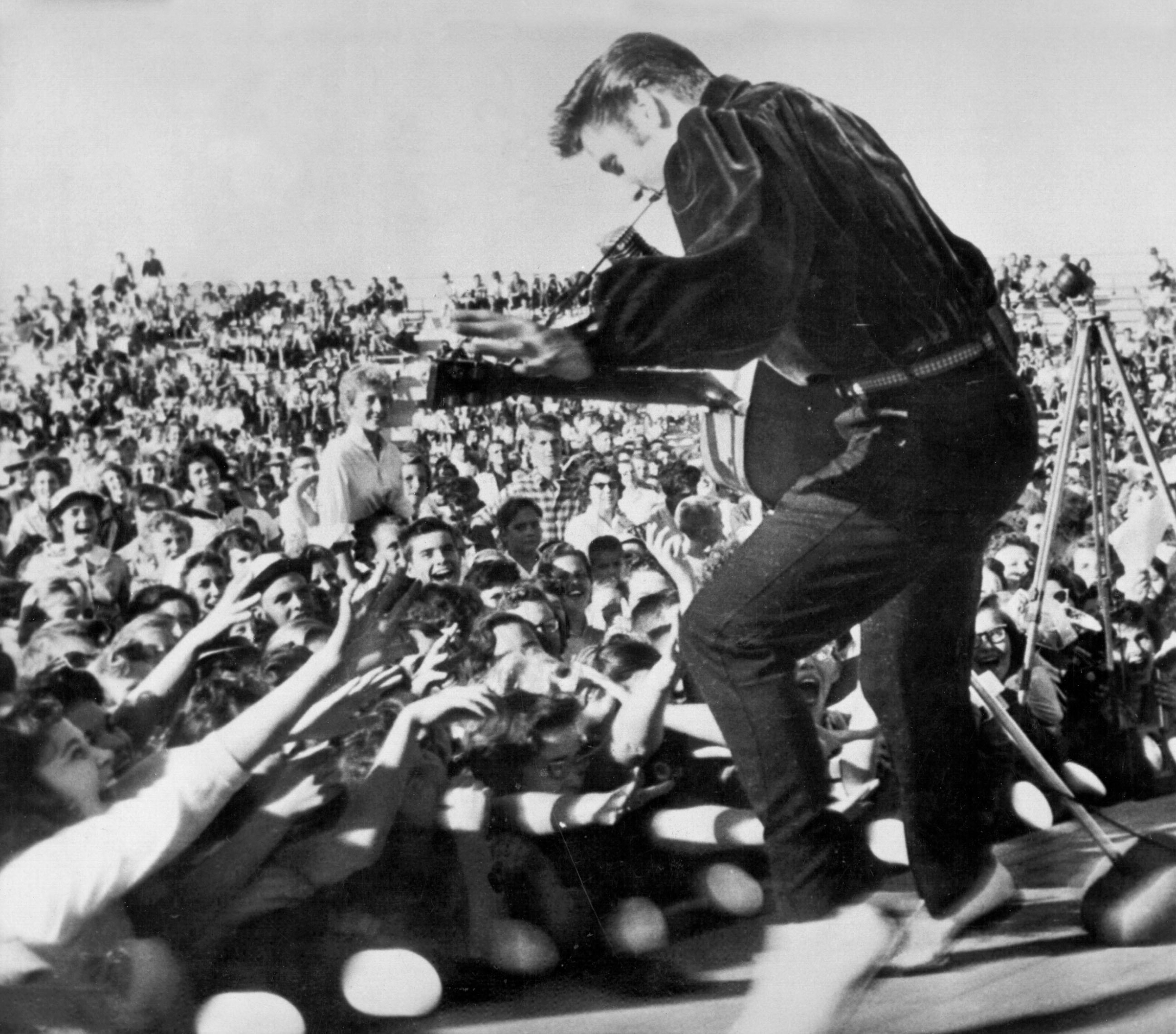 Elvis performs outside to adoring fans on Sept. 26, 1956 in his hometown of Tupelo, Miss.