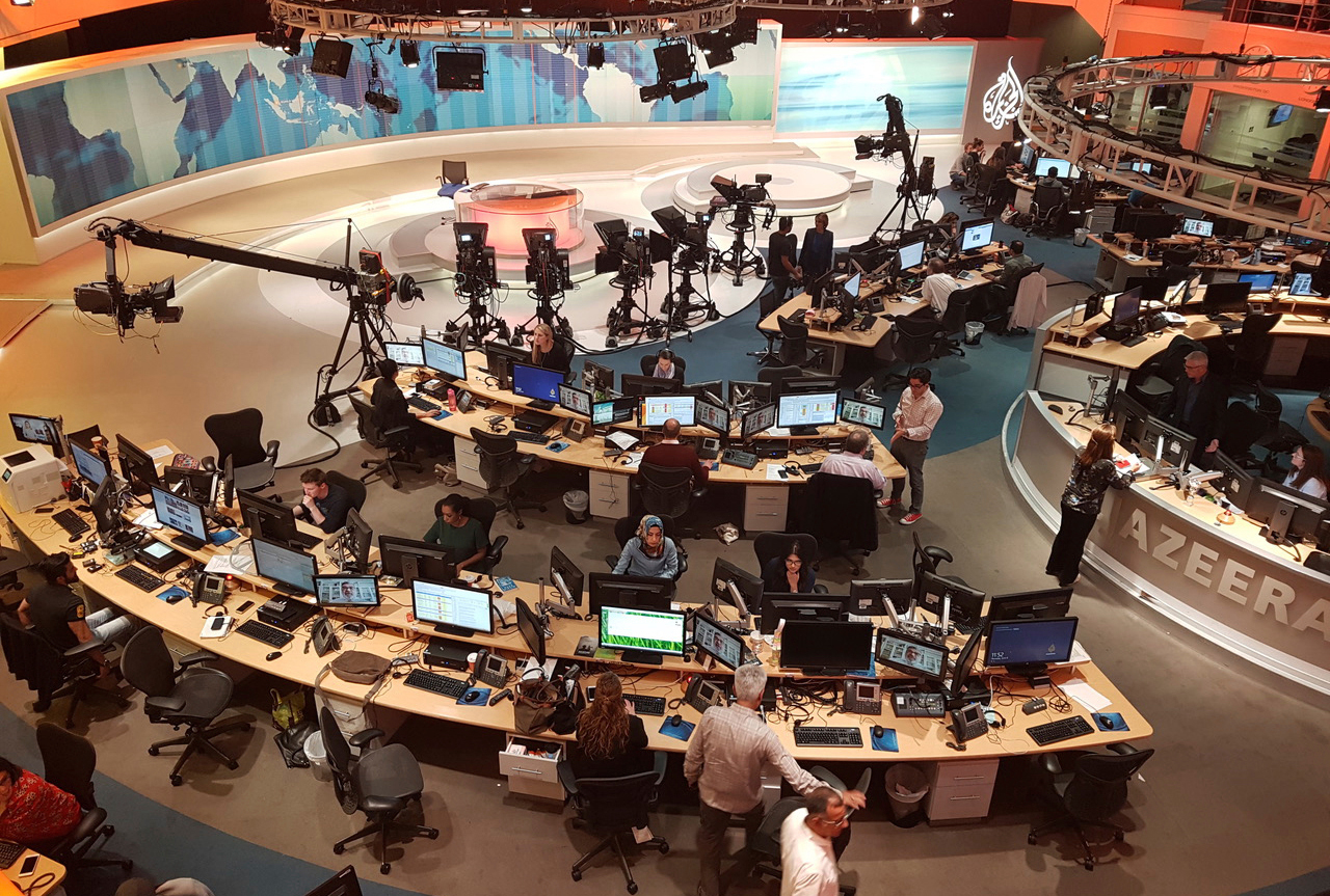Al Jazeera staffers work in Doha on June 8, 2017.