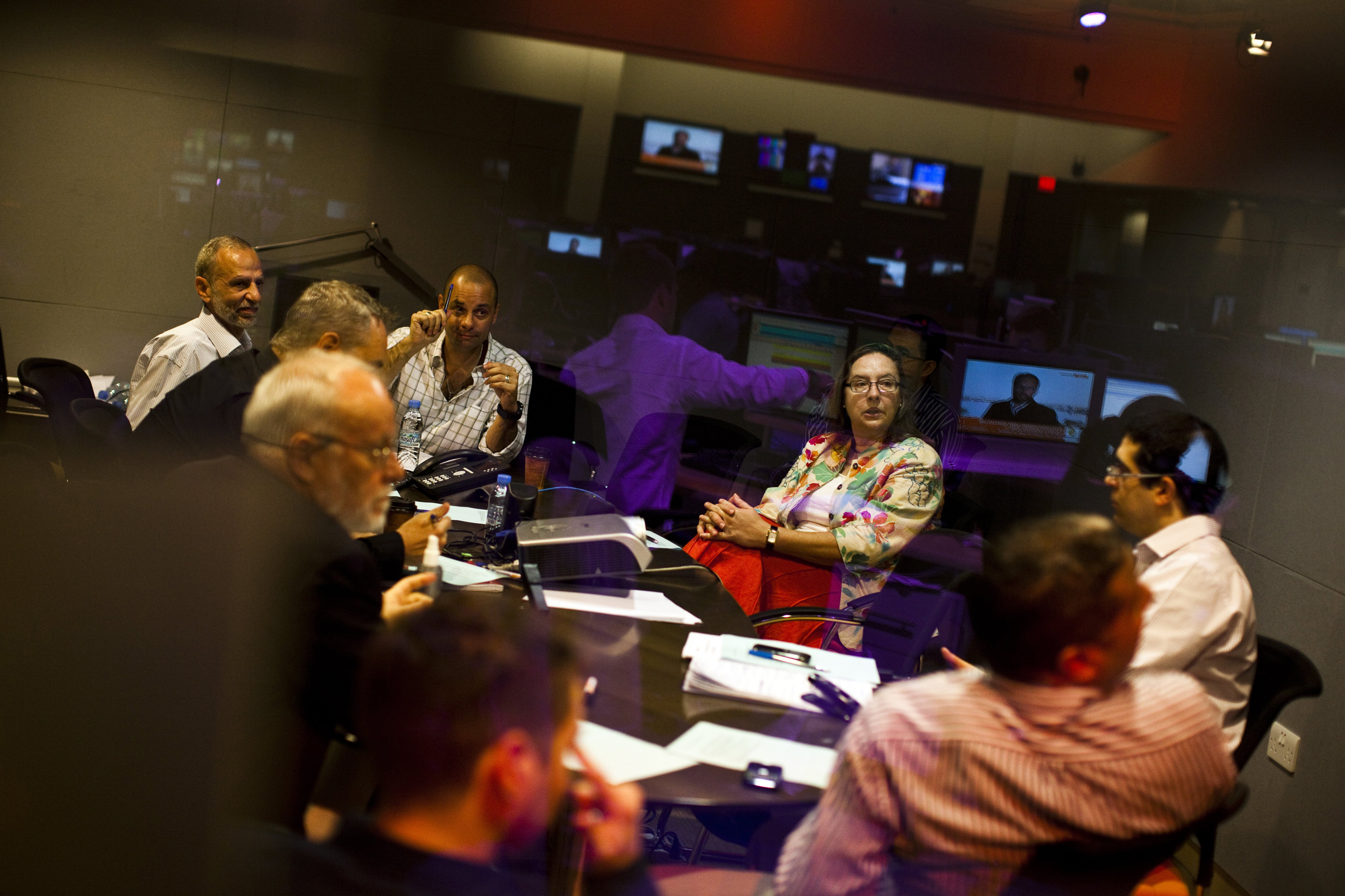 Heather Allan, then a News Manager at Al Jazeera English, takes part in a morning editorial meeting in Doha on March 23, 2011.