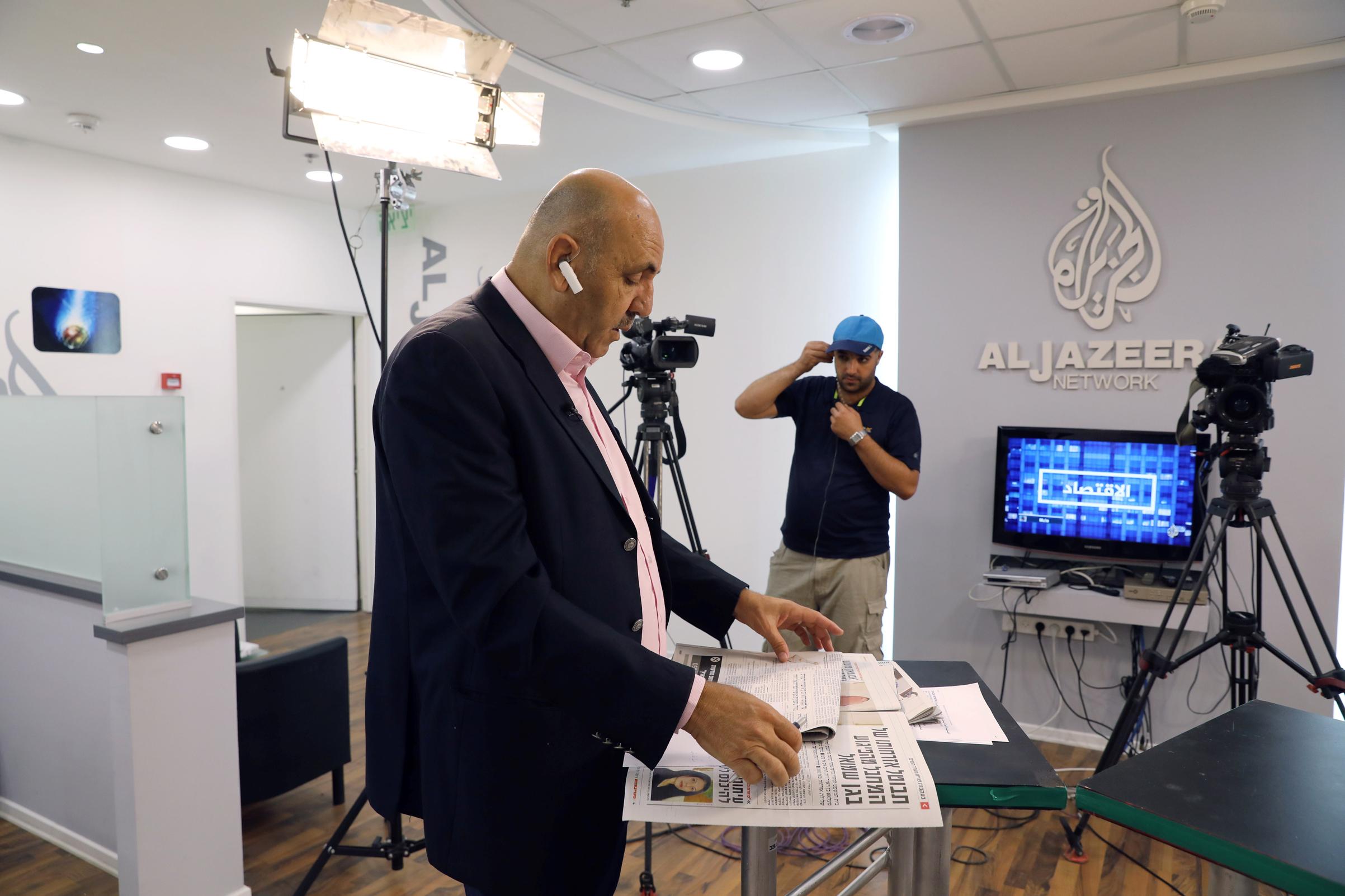 Employees work inside the Al Jazeera in Jerusalem on Aug. 7, 2017.