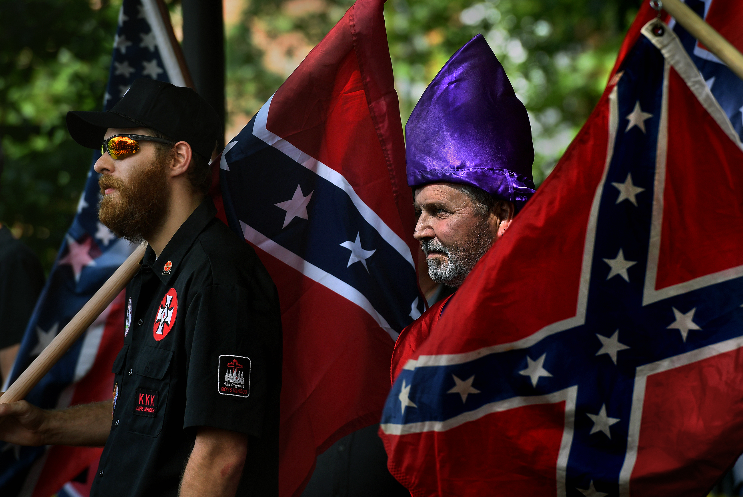 KKK members watch as anti-KKK groups chanted against them.