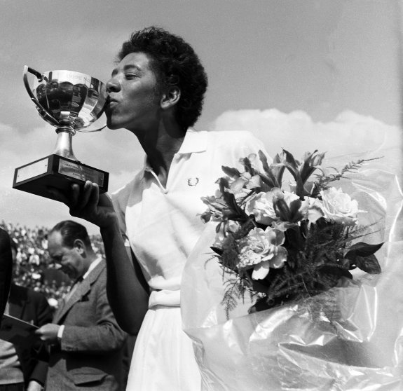 ALTHEA GIBSON: The first black athlete to cross the color line of international tennis and th efirst person of color to win a Grand Slam title in 1956.