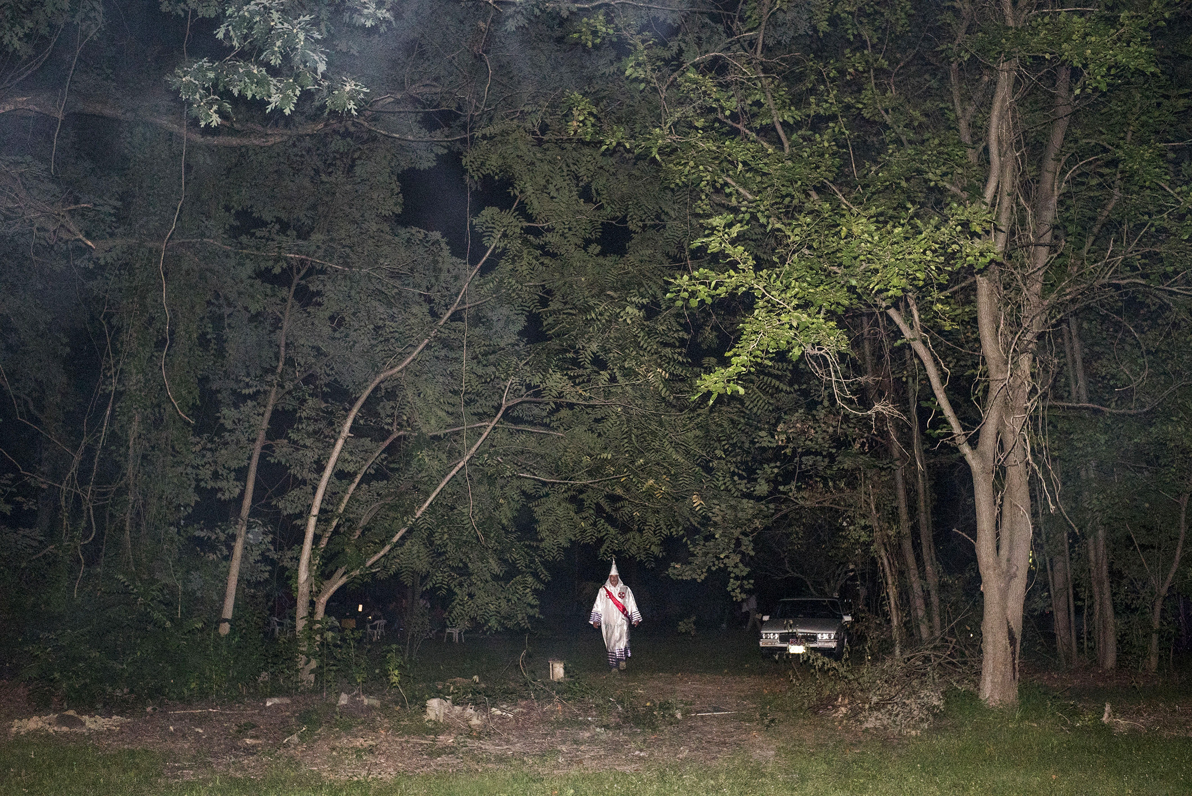 A Ku Klux Klan member in 2015 after a Maryland cross lighting, one of the group's rituals
