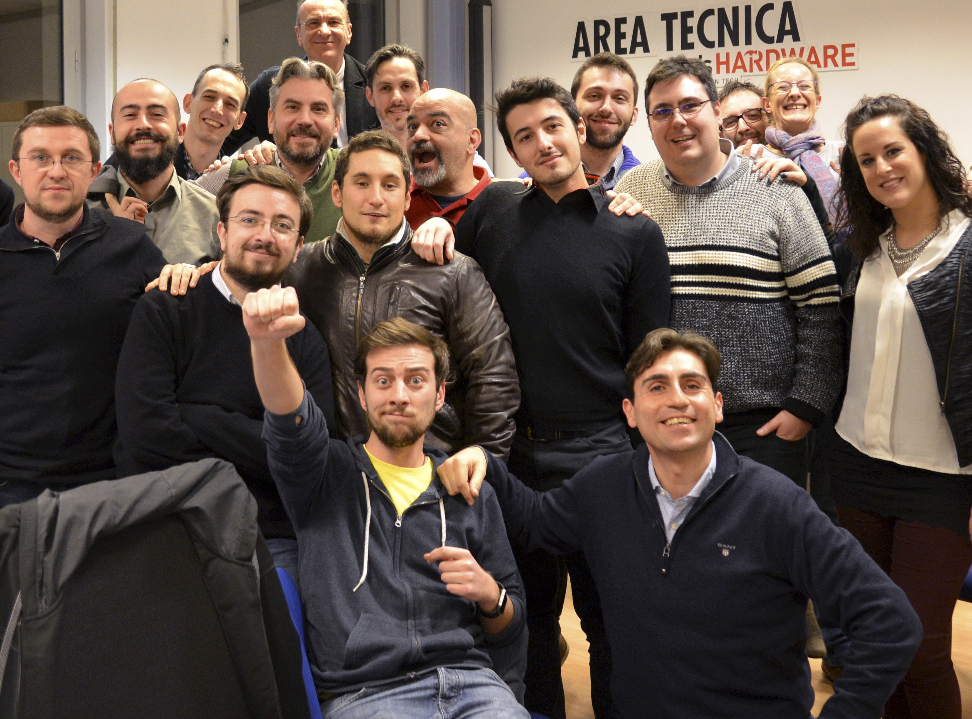 This December 2016 photo provided Aug. 18, 2017 shows Bruno Gulotta, at center wearing a black shirt, with his colleagues at their office in Legnano, near Milan, Italy.