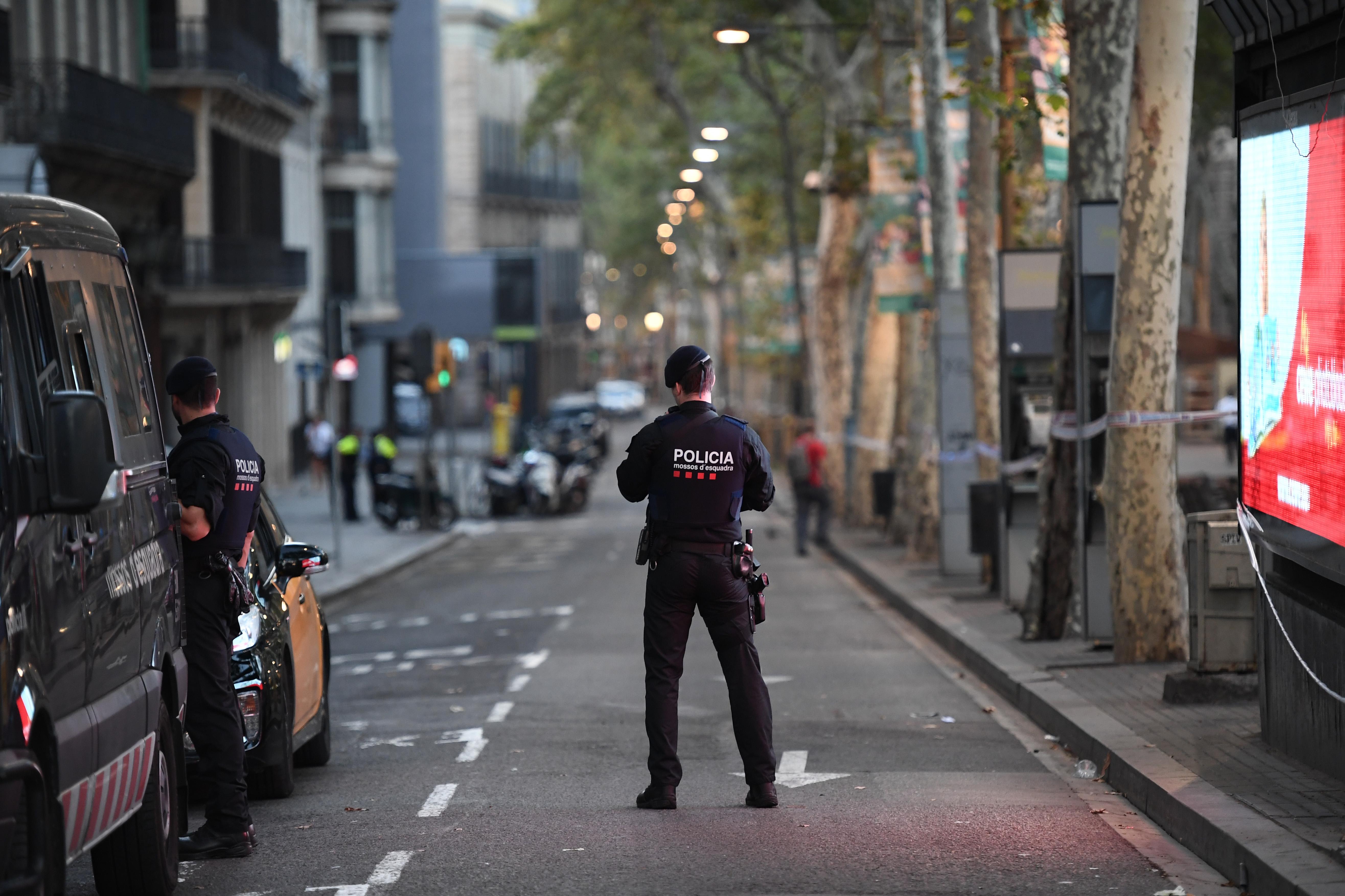 A police officer patrols on Las Ramblas following yesterday's terrorist attack, on Aug. 18, 2017 in Barcelona.