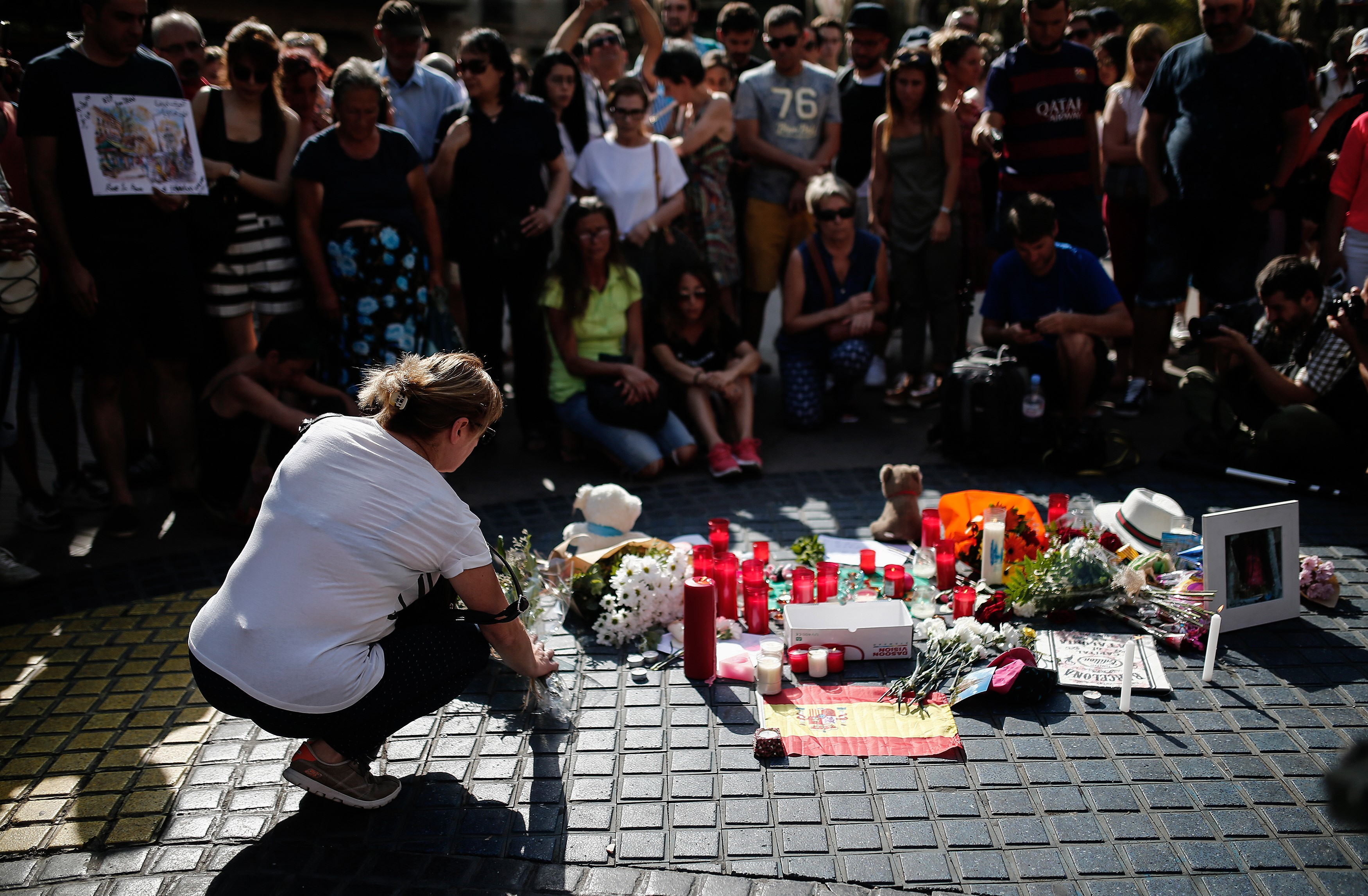 People gather and mourn at La Rambla boulevard for the victims those who lost their lives in terror attack killing at least 13 people when a white van ploughed into a crowd in central Barcelona.