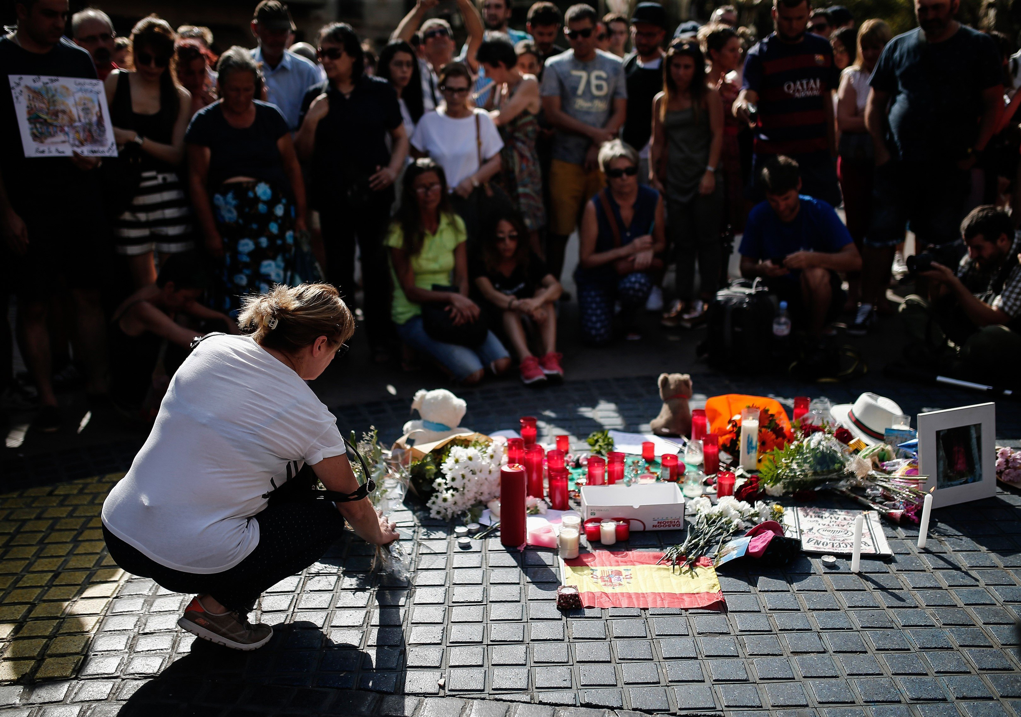 People gather and mourn at La Rambla boulevard for the victims those who lost their lives in terror attack in central Barcelona, on Aug. 18, 2017.