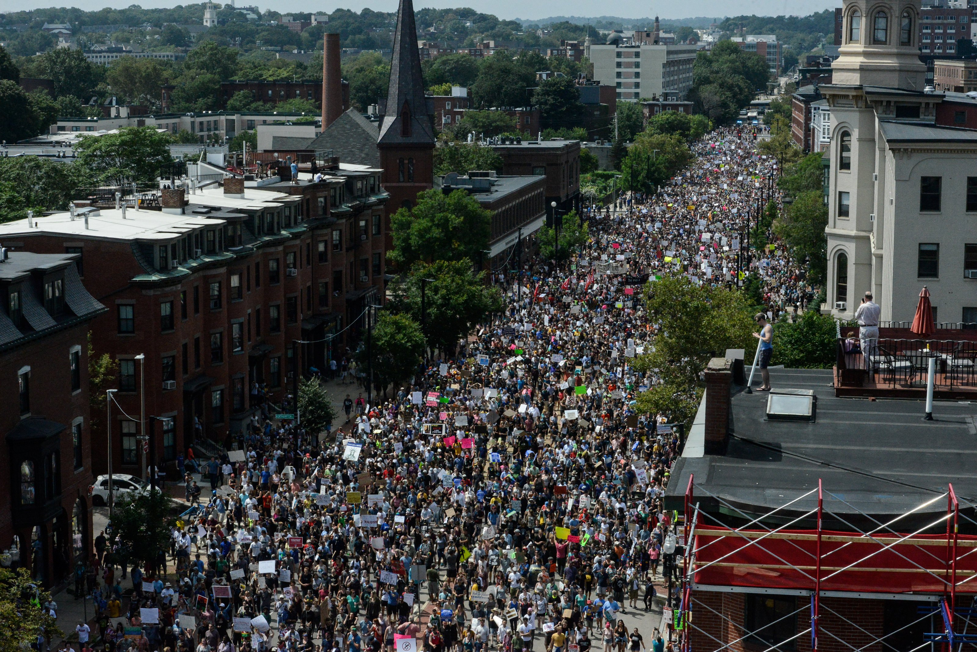 A large crowd of people march towards the Boston Commons to protest the Free Speech Rally, Aug. 19, 2017.