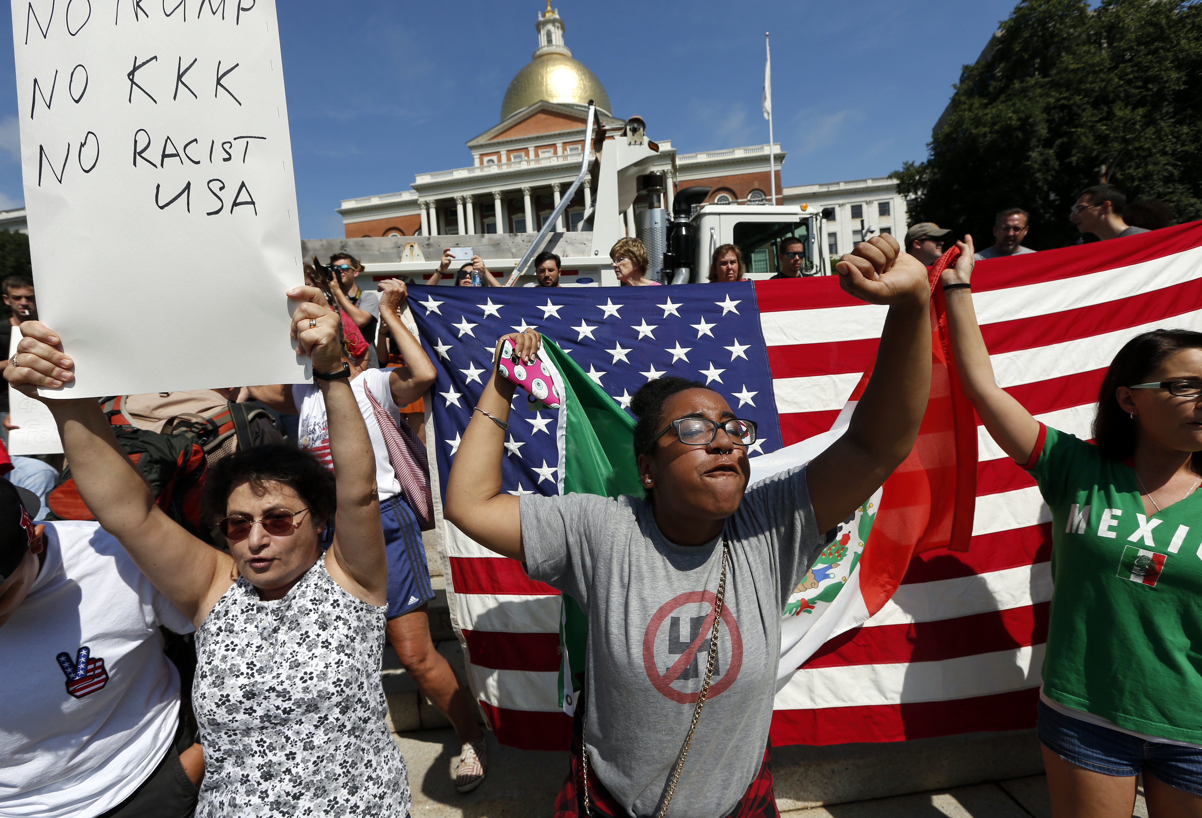Counter-protesters at the Statehouse before a planned  Free Speech  rally by conservative organizers begins on the adjacent Boston Common on Aug. 19, 2017.
