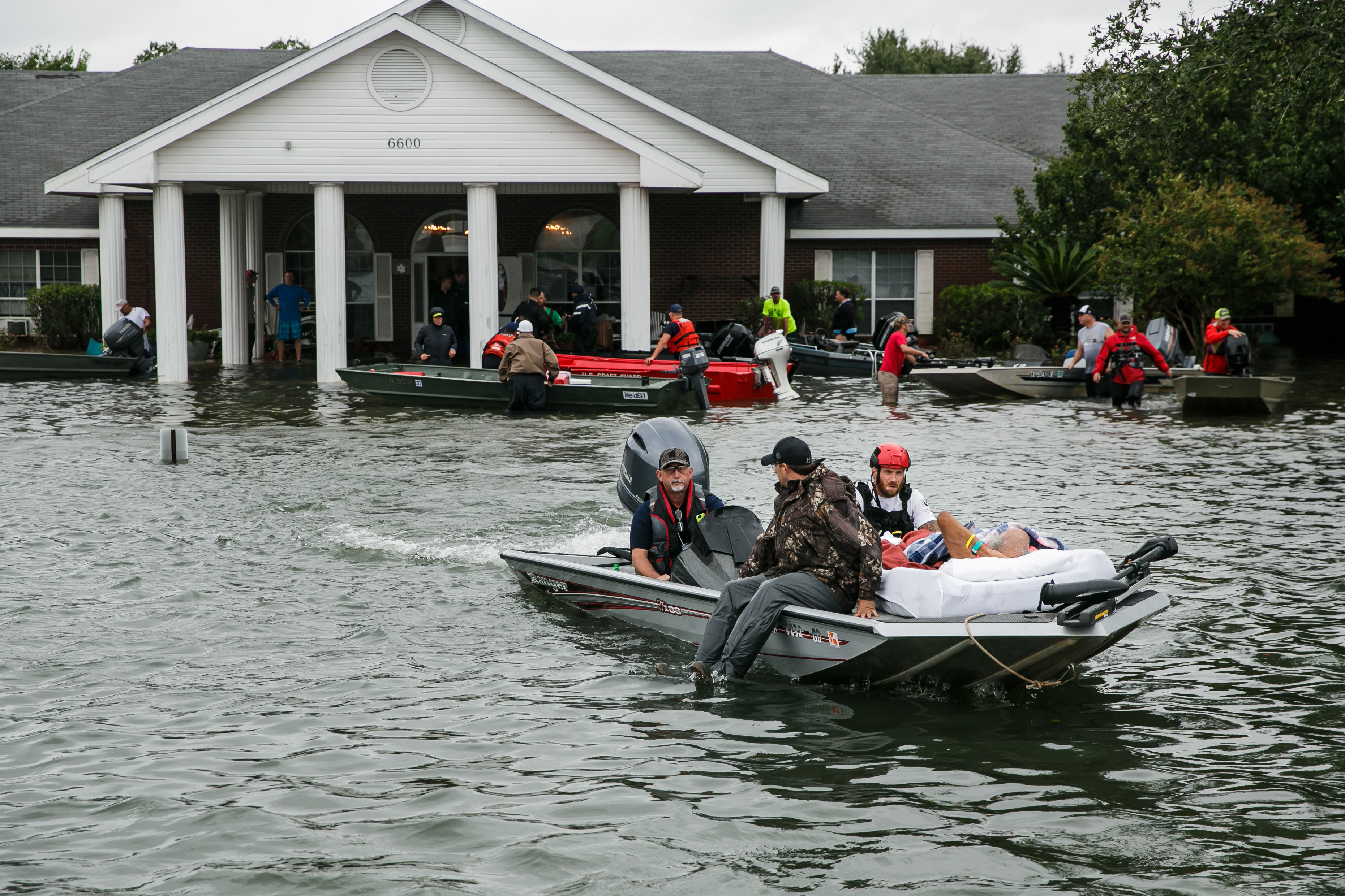 Search and rescue volunteers rescue patients from the Cypress Glen nursing home engulf in floodwater in Port Arthur, Texas, on Aug. 30, 2017.