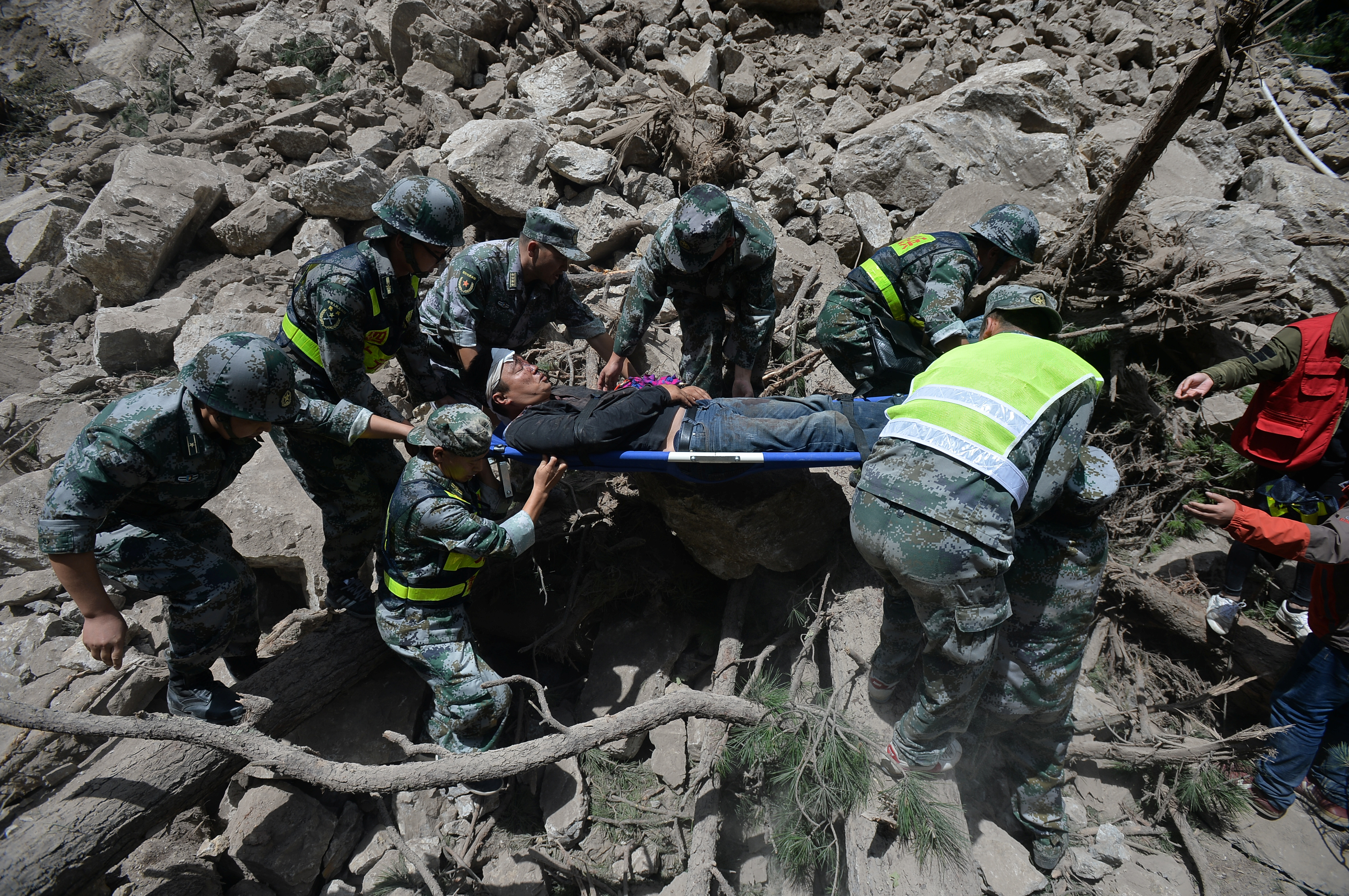 Chinese paramilitary police carry a survivor after an earthquake in Jiuzhaigou county, Ngawa prefecture, Sichuan province, China on Aug. 9, 2017.