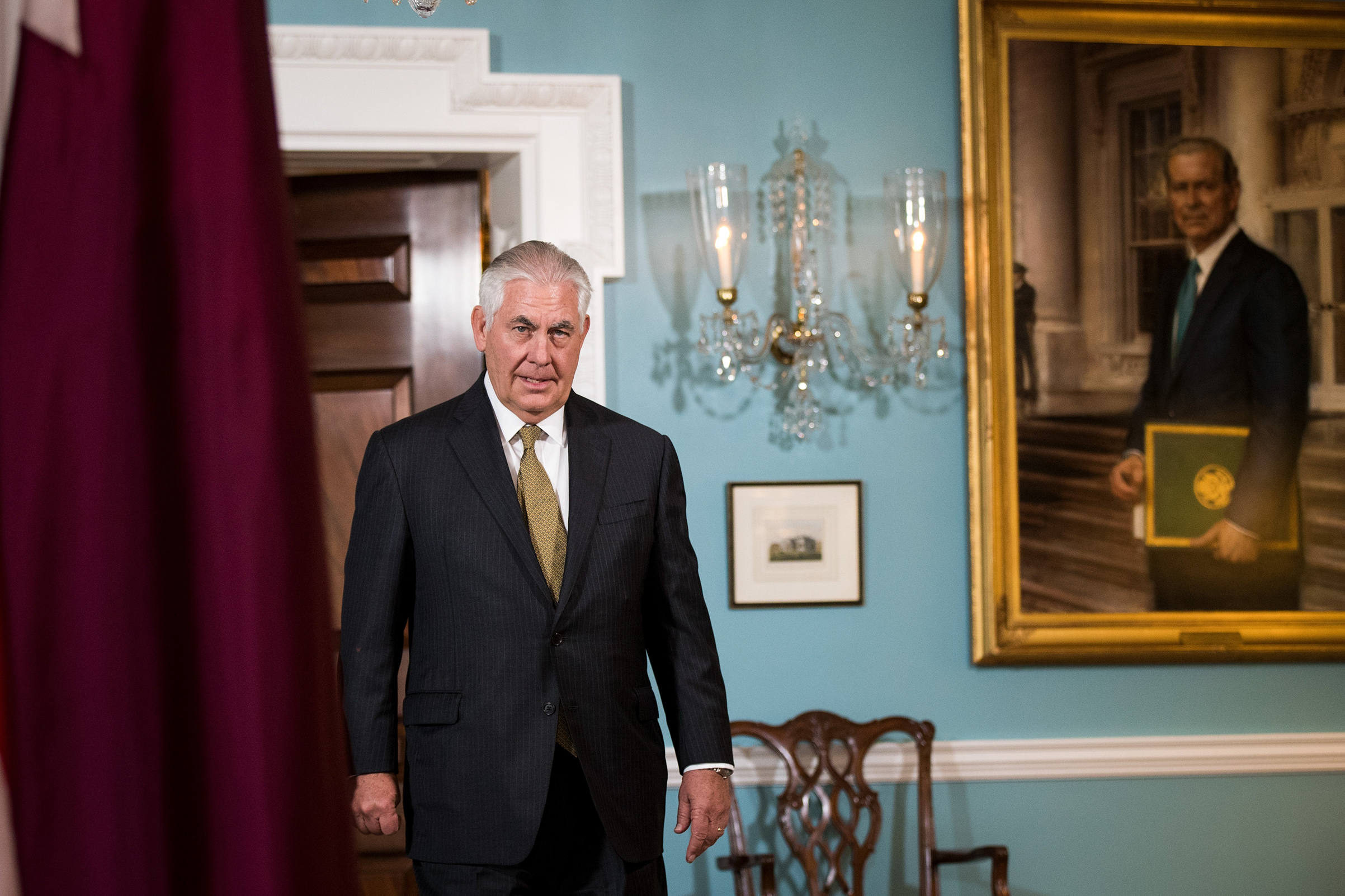 Secretary of State Rex Tillerson exits a brief media availability before his meeting with Qatari Foreign Minister Sheikh Mohammed Bin Abdulrahman Al Thani at the State Department, July 26, 2017 in Washington. When prompted by a reporter's question, Tillerson said 'I'm not going anywhere' and that he will stay on as Secretary of State 'as long as the president lets me.'