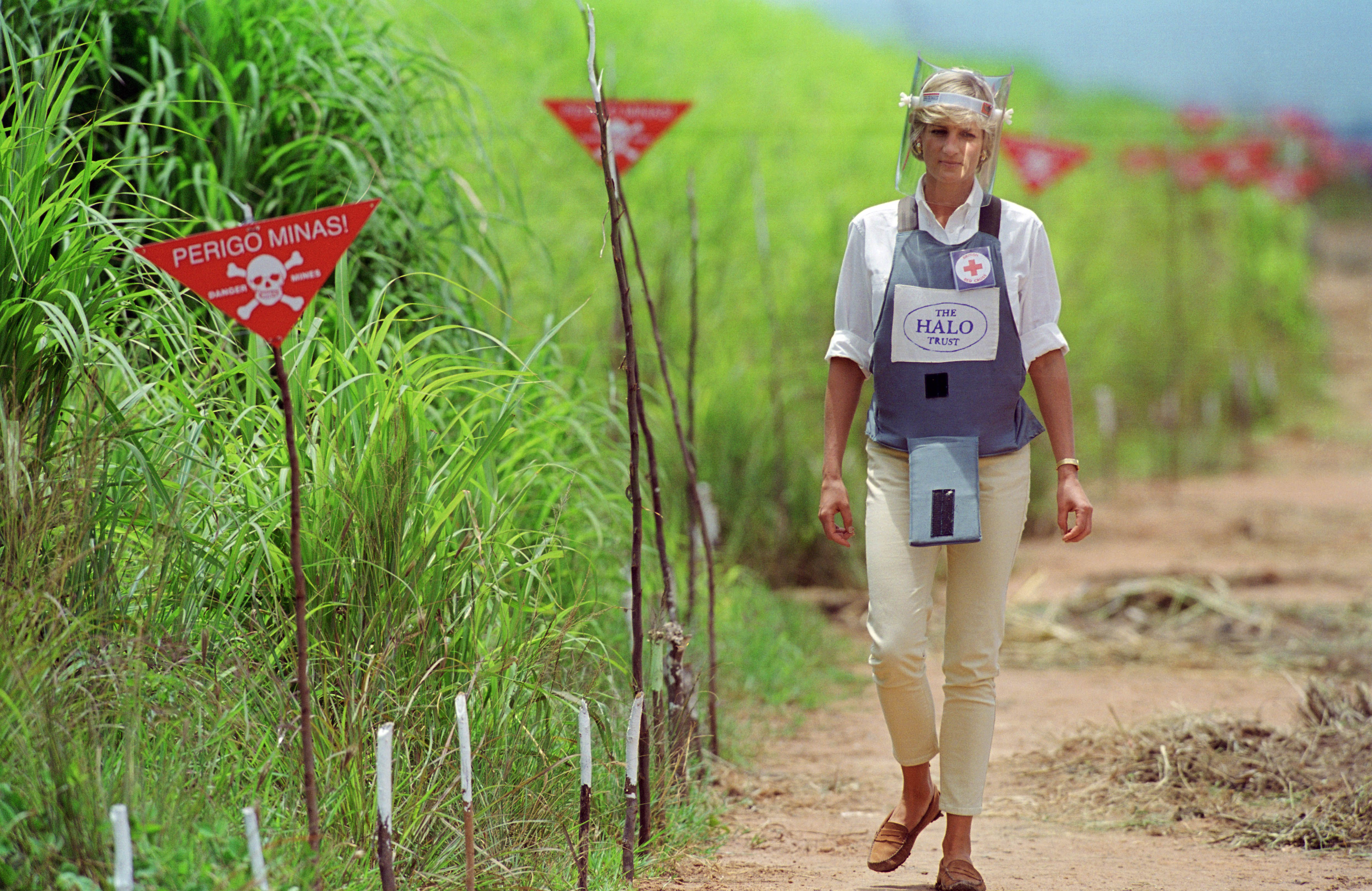 Diana, Princess of Wales wearing protective body armour and a visor visits a landmine minefield being cleared by the charity Halo in Huambo, Angola