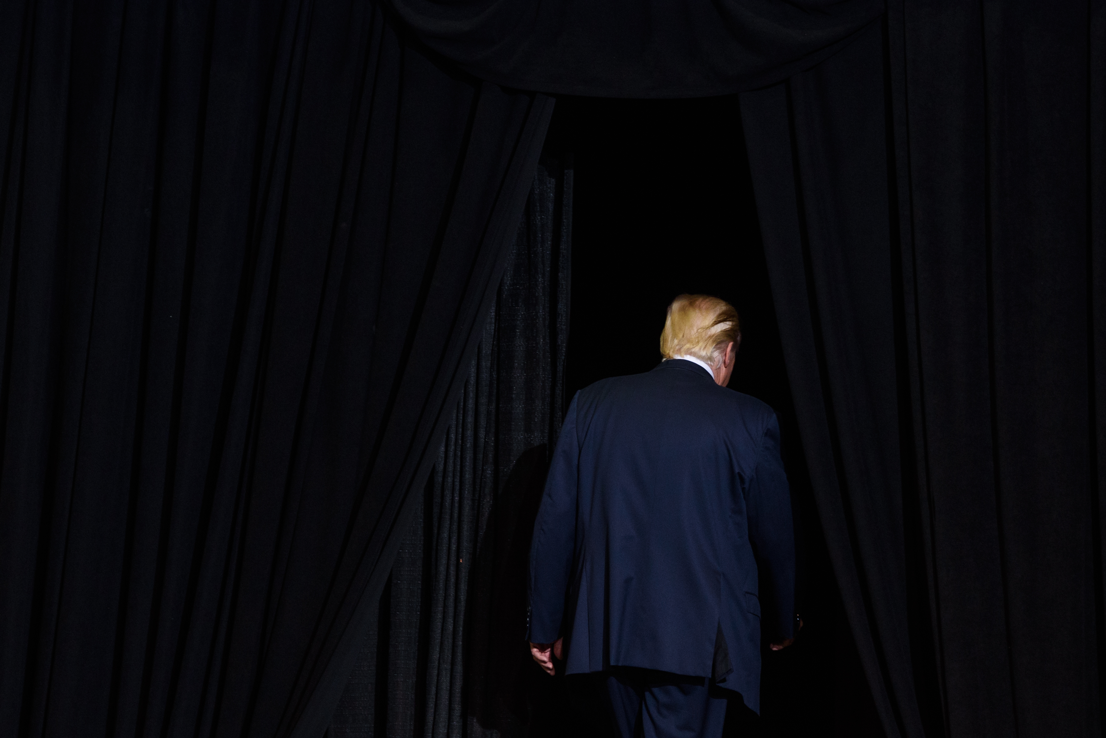 President Donald Trump walks off the stage after his campaign rally at the Big Sandy Superstore Arena on August 3, 2017 in Huntington, West Virginia.