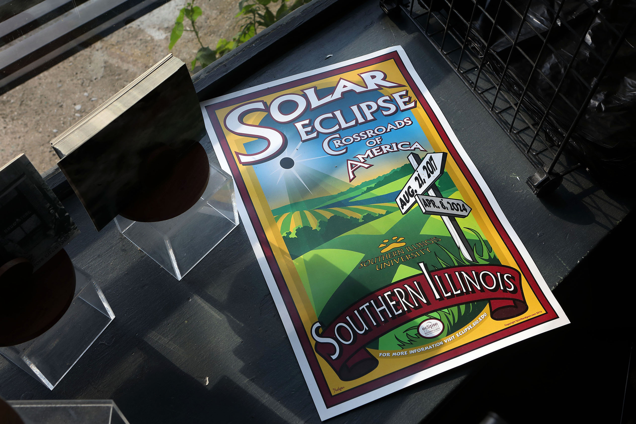 A sign promoting Makanda, Illinois as the  Solar Eclipse Crossroads of America  sits on the window ledge at the Eclipse Kitchen in Makanda on July 19, 2017.