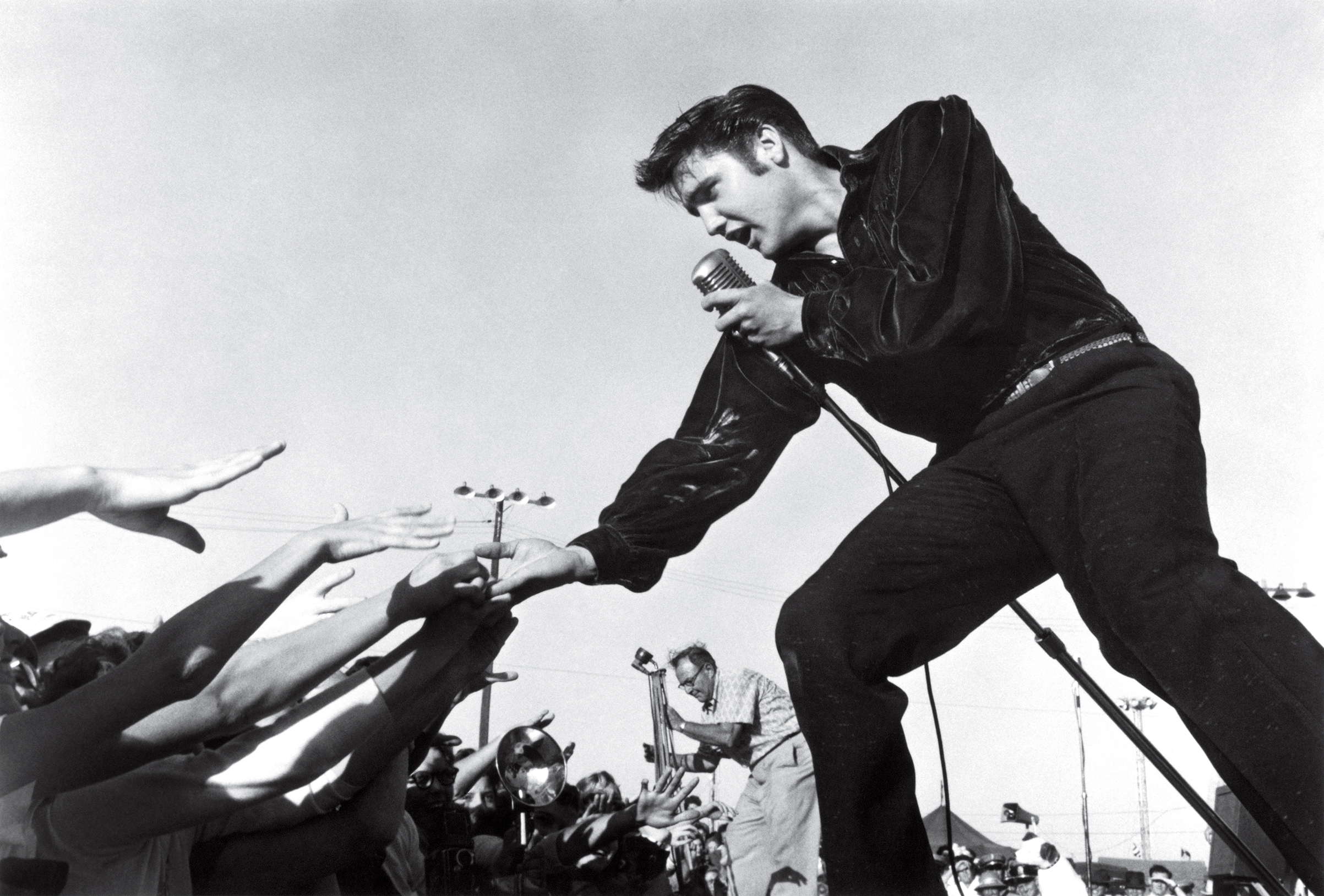 Elvis Presley performing at the Mississippi-Alabama Fair and Dairy Show in 1956 in Tupelo, Miss.