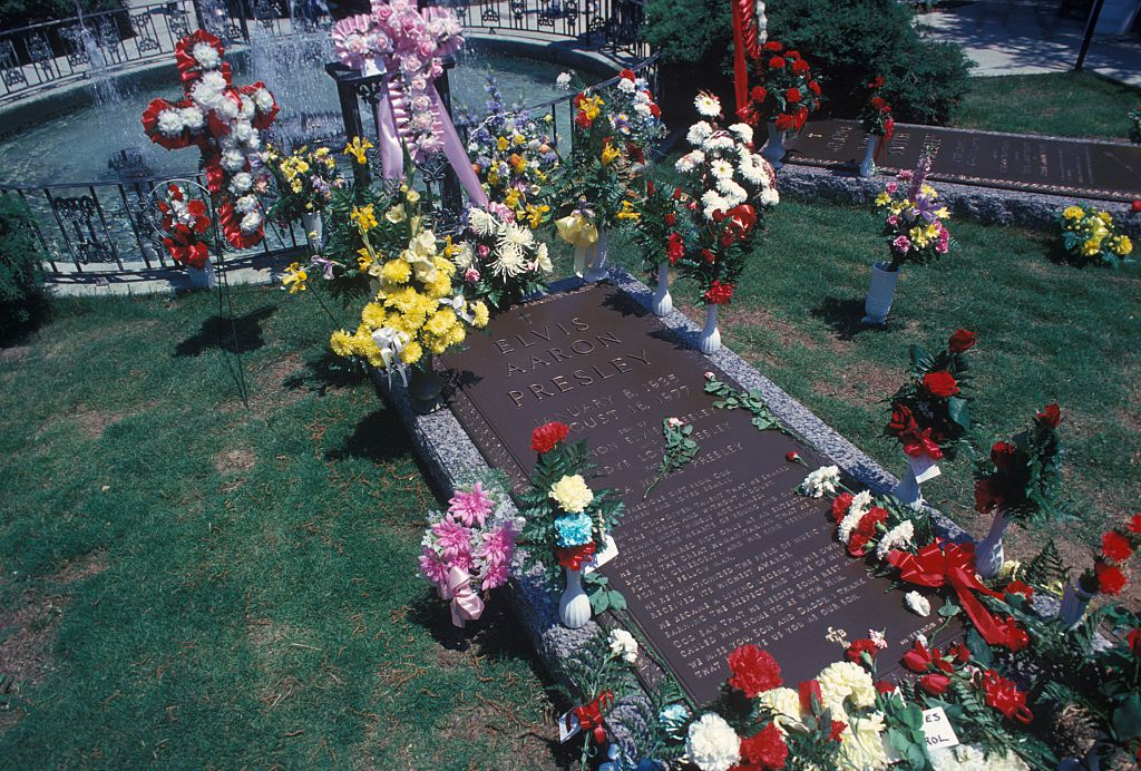 Flowers adorn the grave of Elvis Presley at his Graceland home on May 1, 1979 in Memphis, Tennessee.