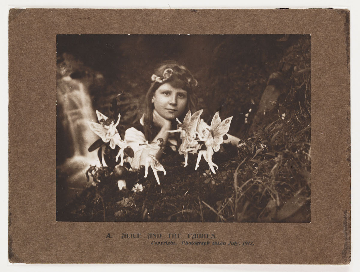 A photograph of Frances 'Alice' Griffiths (1907-1986) taken by her cousin Elsie 'Iris' Wright (1901-1988), using her father Arthur's Midg quarter-plate camera, the first in the 'Cottingley Fairies' series.