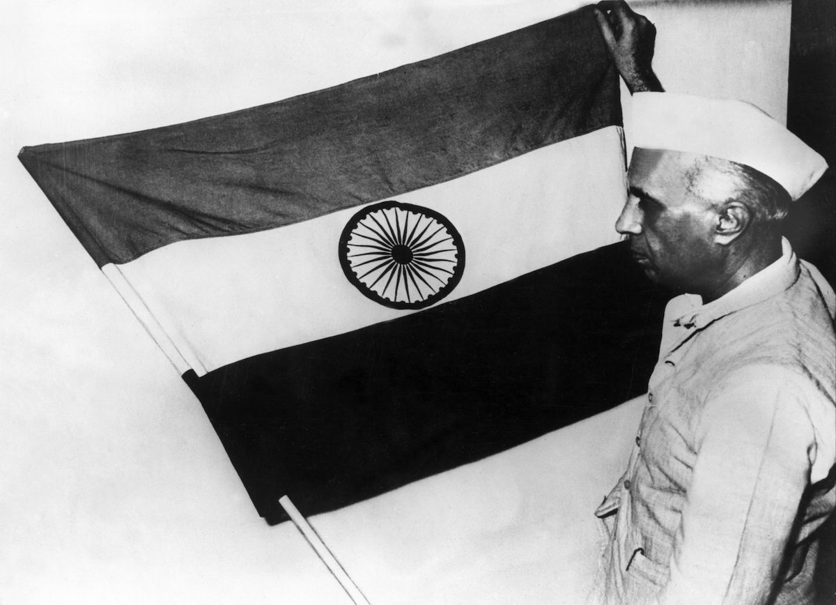 Jawaharlal Nehru presenting the national flag of India during a meeting of the constituent assembly on July 30, 1947.