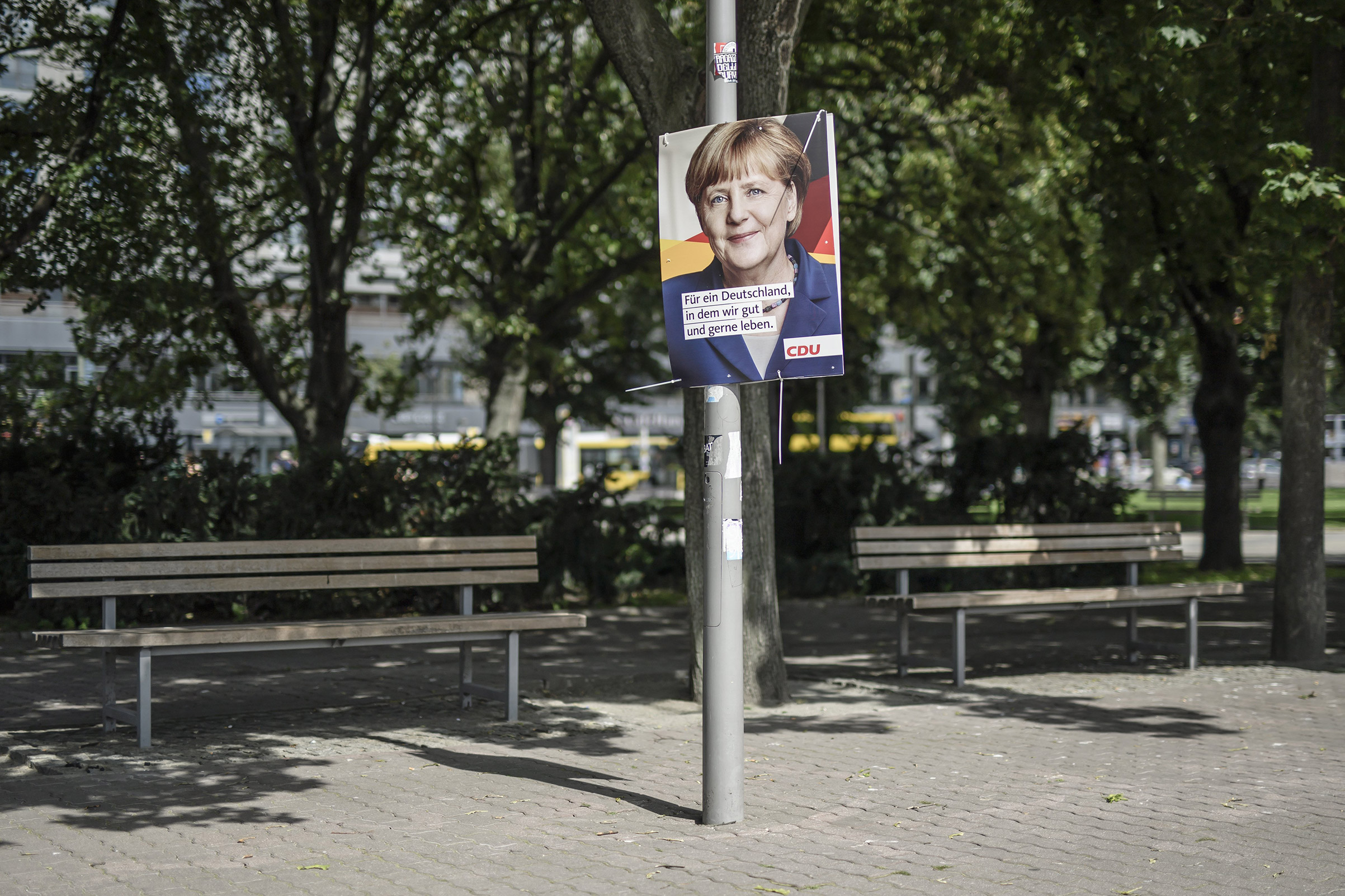 A campaign poster for Chancellor Angela Merkel in Berlin. The text reads,  For a Germany in which we live well and in which we like to live.
