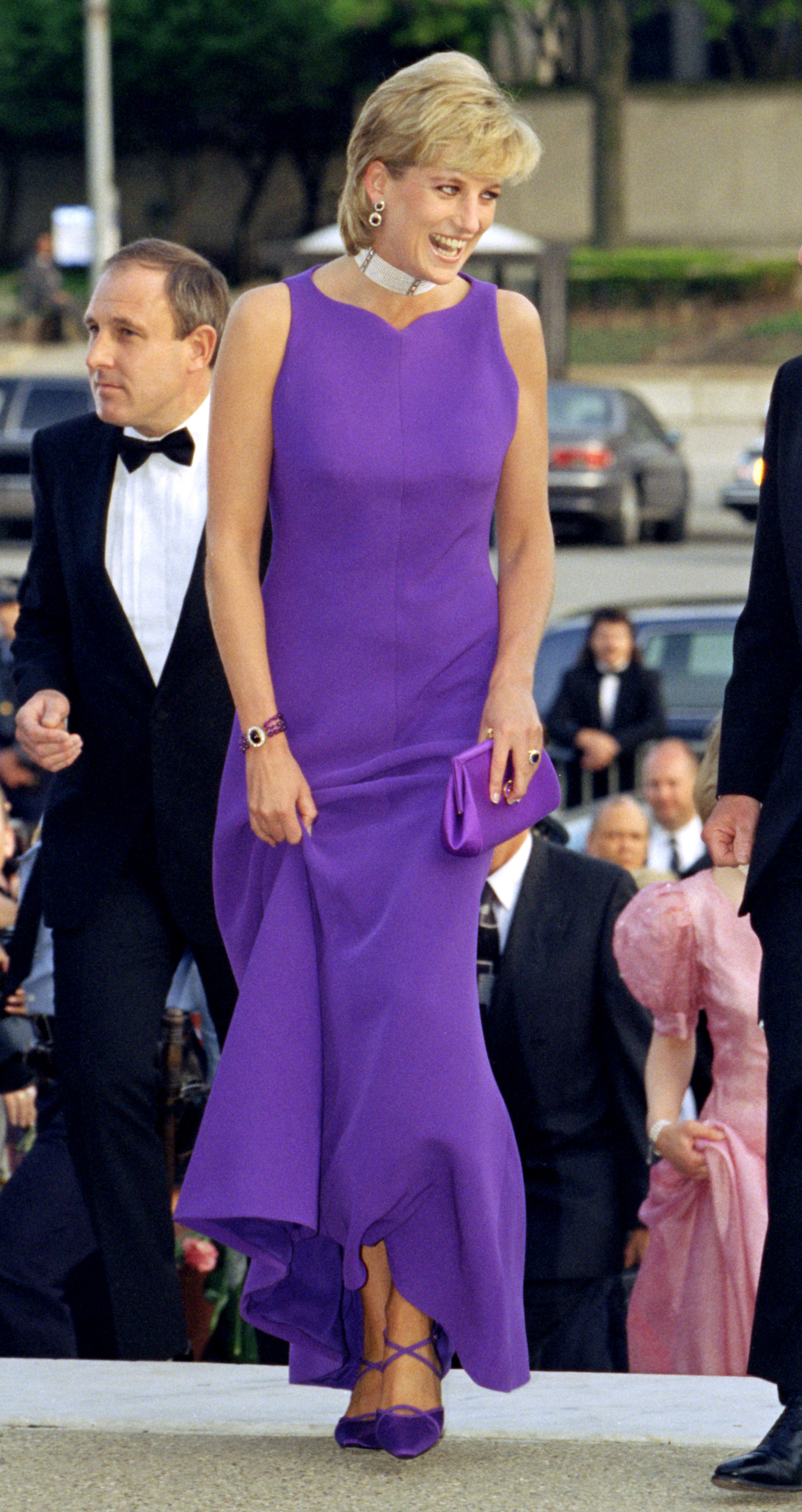 The princess paired a purple gown by Versace with a matching Jimmy Choo bag for an event in 1996.
