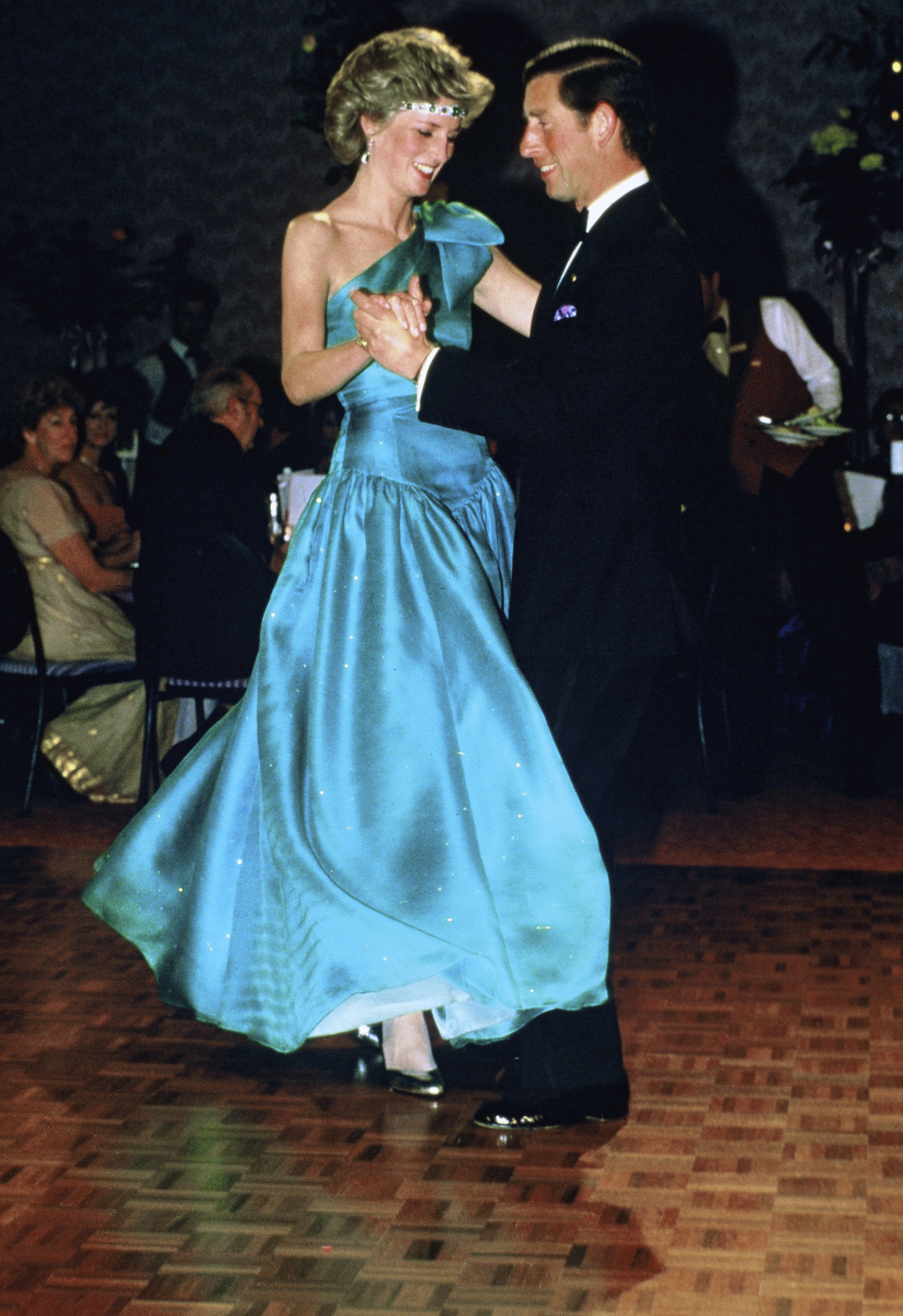 Princess Diana didn't shy away from bold fashion choices, often selecting dresses in vibrant colors. Here, her teal gown was nicely complemented by her repurposing a choker from the royal family as a tiara of sorts.