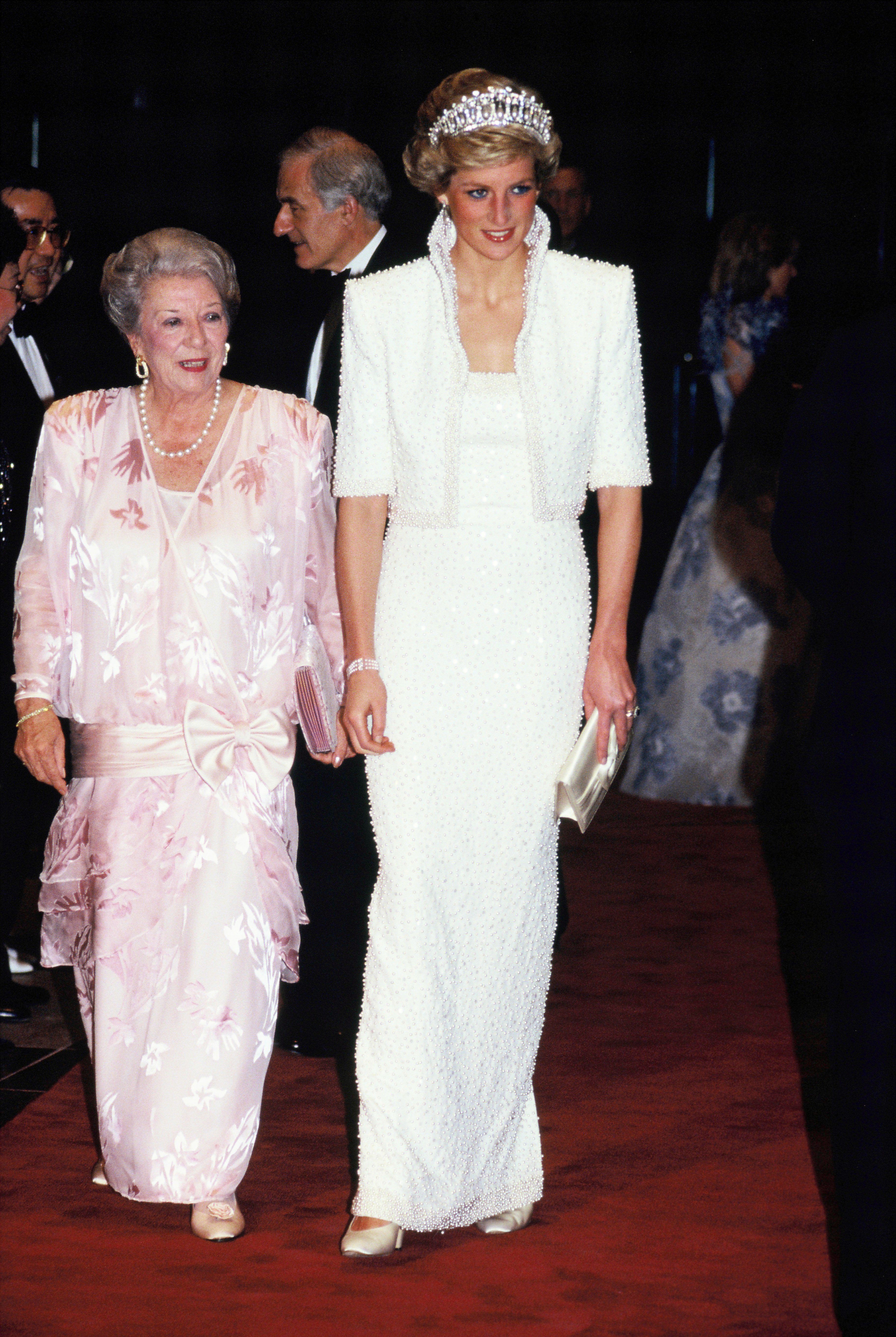 This embellished white gown that Diana wore in Hong Kong in 1989 was dubbed the  Elvis dress  by the press. The princess paired the Catherine Walker look with her favorite Cambridge lover's knot tiara.