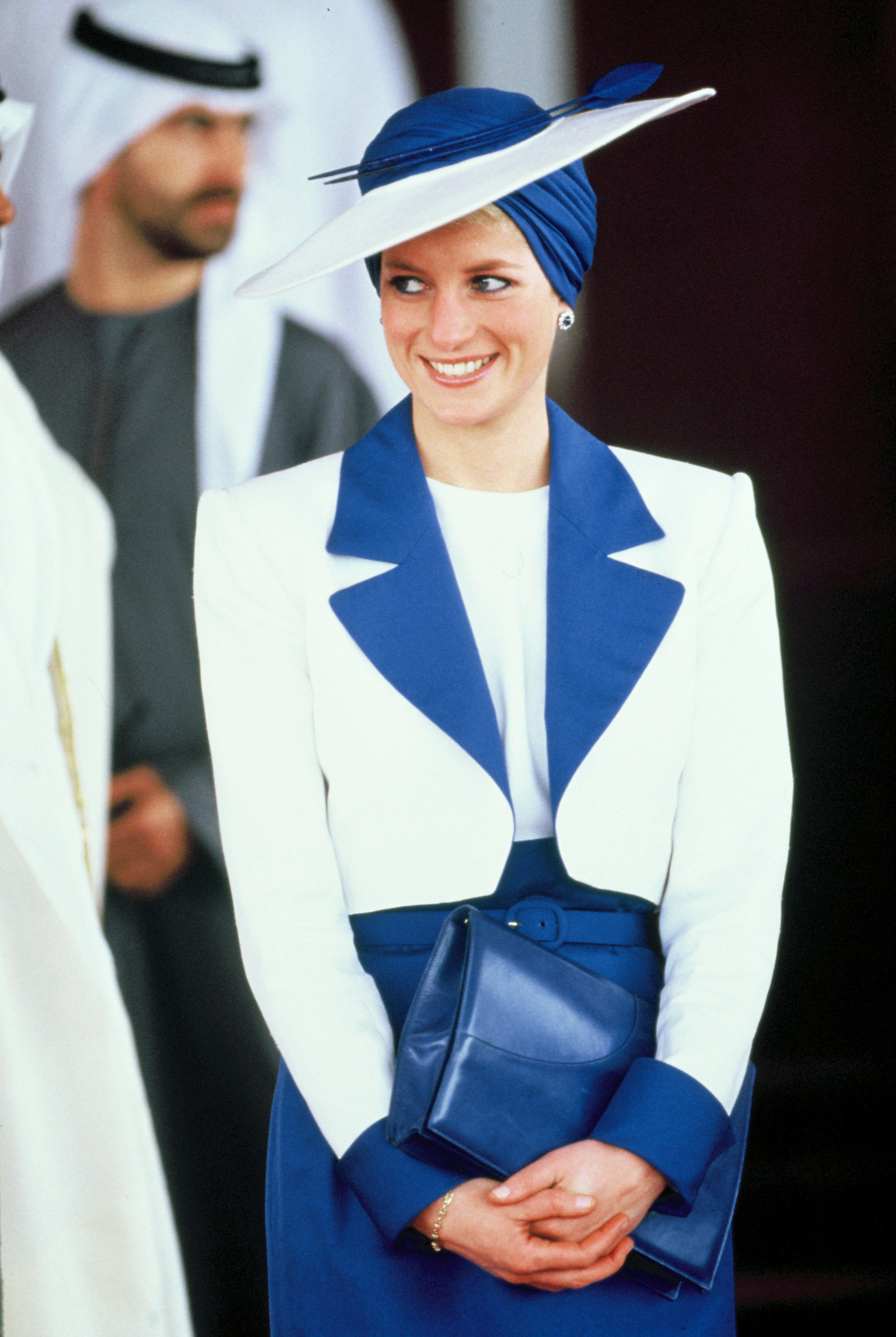 While in Dubai in 1989, Diana wore a Catherine Walker suit and matching Philip Somerville turban hat; the hat was as stylish as it was modest, showing her respect for the customs of the land.