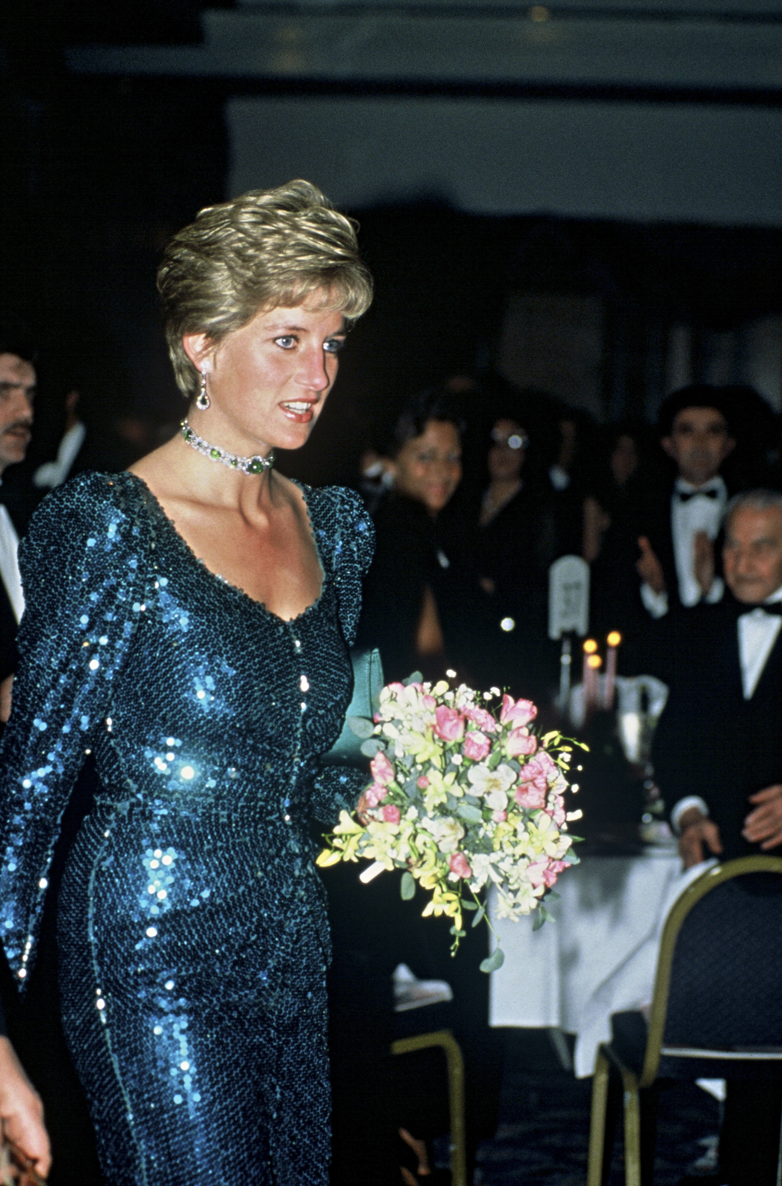 The princess put on the glitz when she sported a blue glitter Catherine Walker dress to attend the Diamond Ball in 1990.