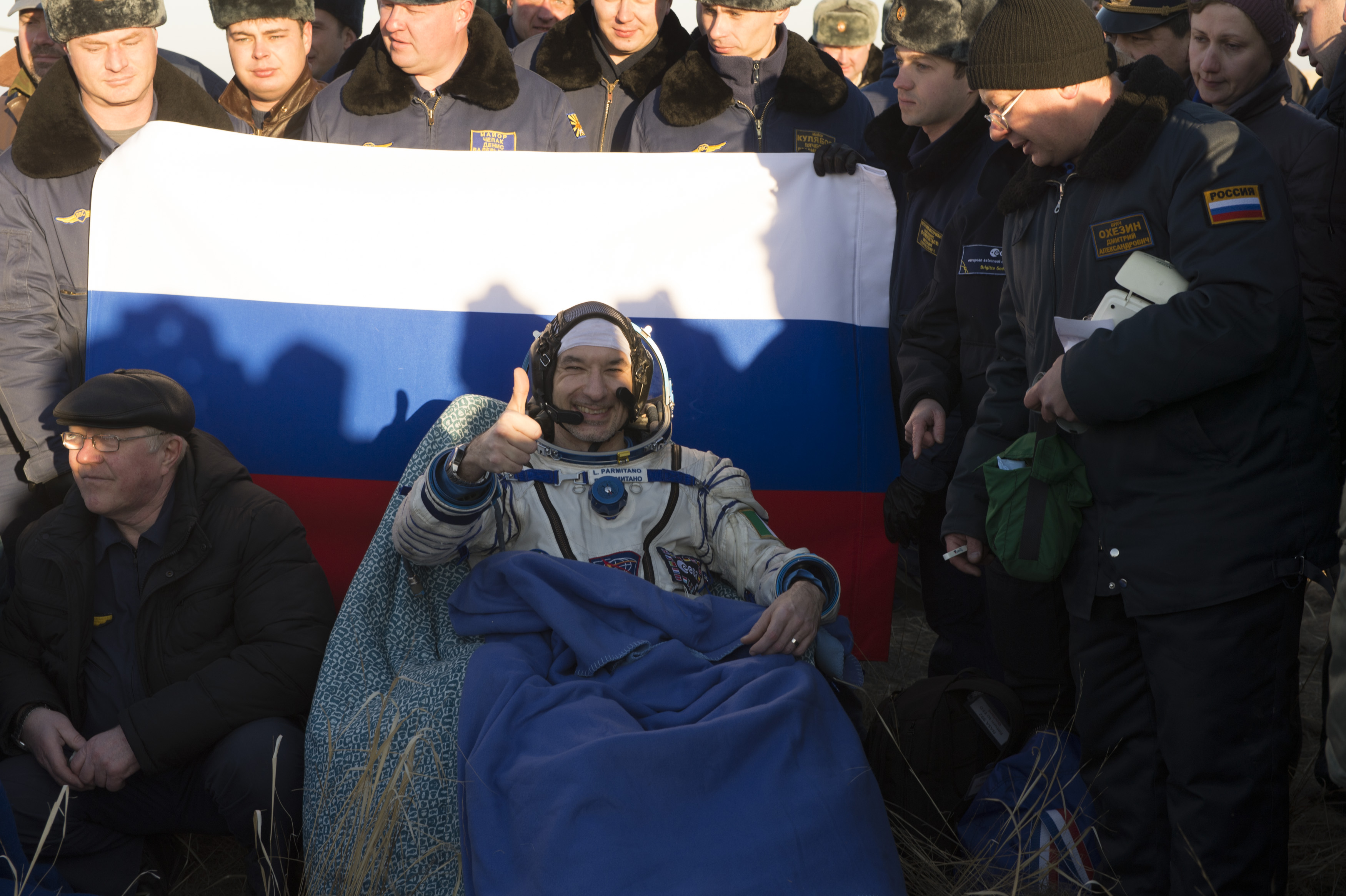 In this handout photo provided by the European Space Agency (ESA), ESA astronaut Luca Parmitano poses for photographs after returning to earth in the Soyuz TMA-09M spacecraft in the Kazakh Steppe region on Novemeber 11, 2013 in Kazakhstan.
