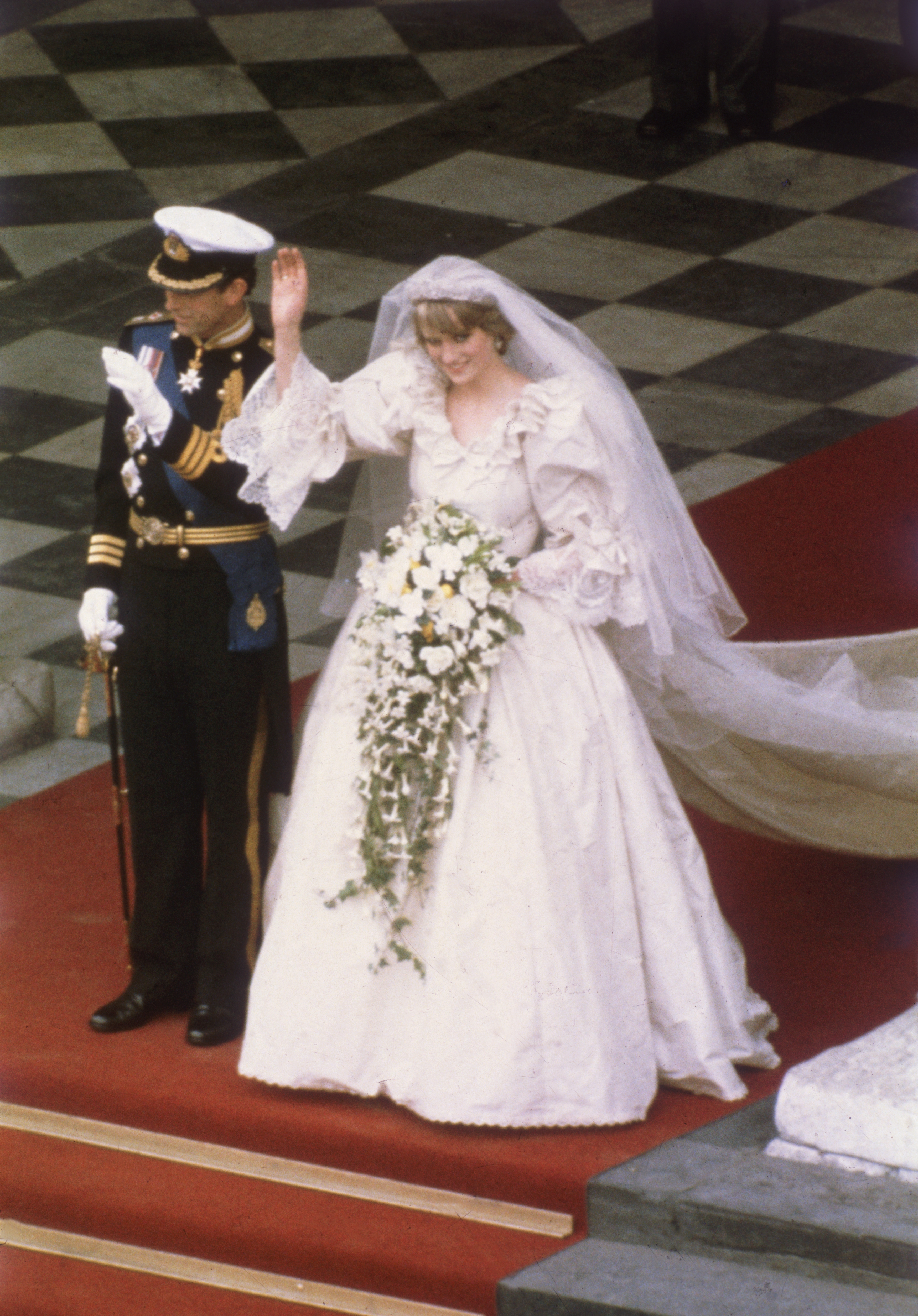Diana's maximalist wedding gown for her July 29, 1981 wedding to Prince Charles was a joint collaboration between the princess and husband and wife design duo David and Elizabeth Emanuel. The dress had a 25 foot train and was made in just 3 months.