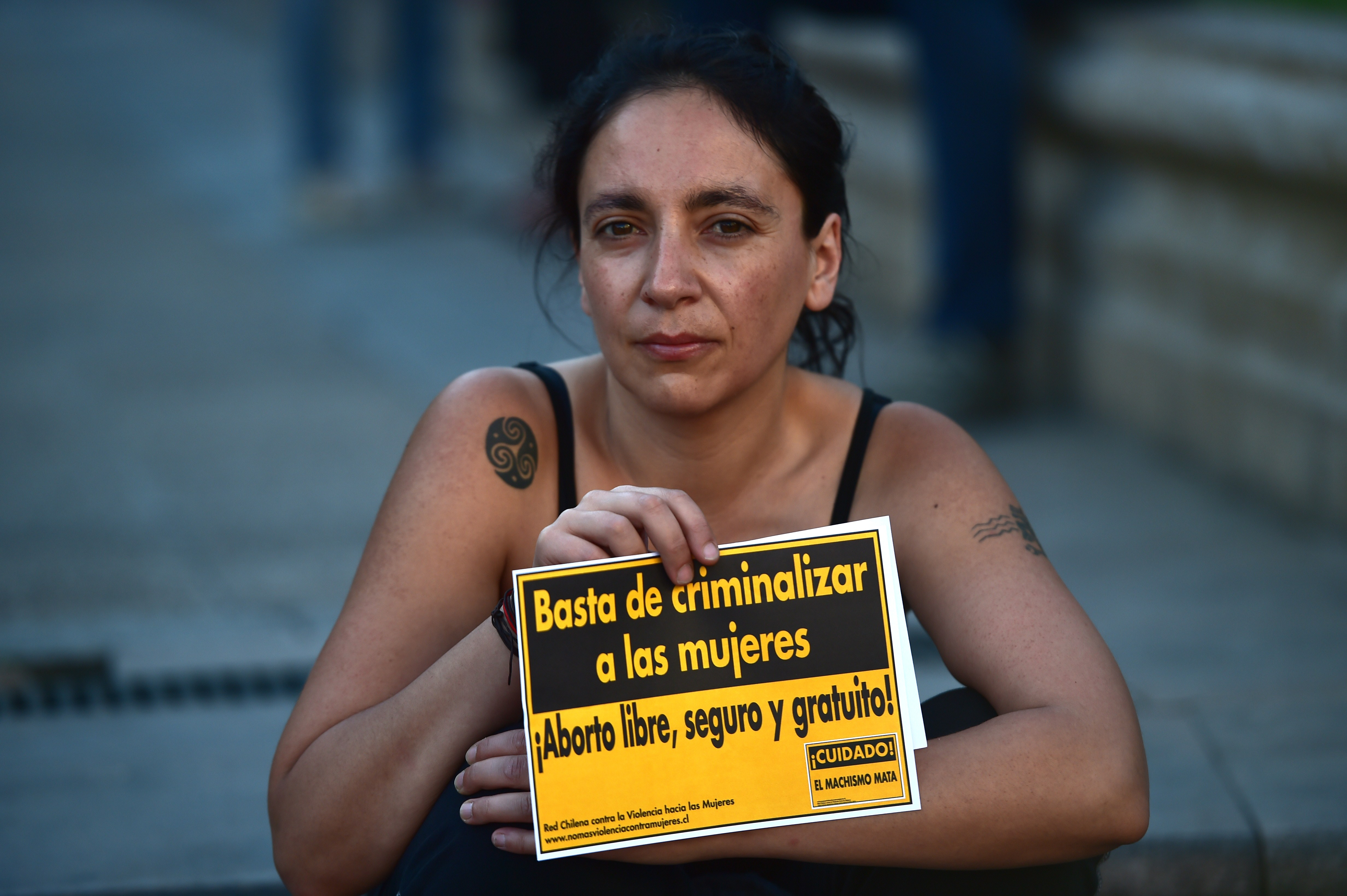 An activist holds a sign reading  Stop criminalizing women. Free and safe abortion  in Santiago, Chile on Nov. 11, 2014.