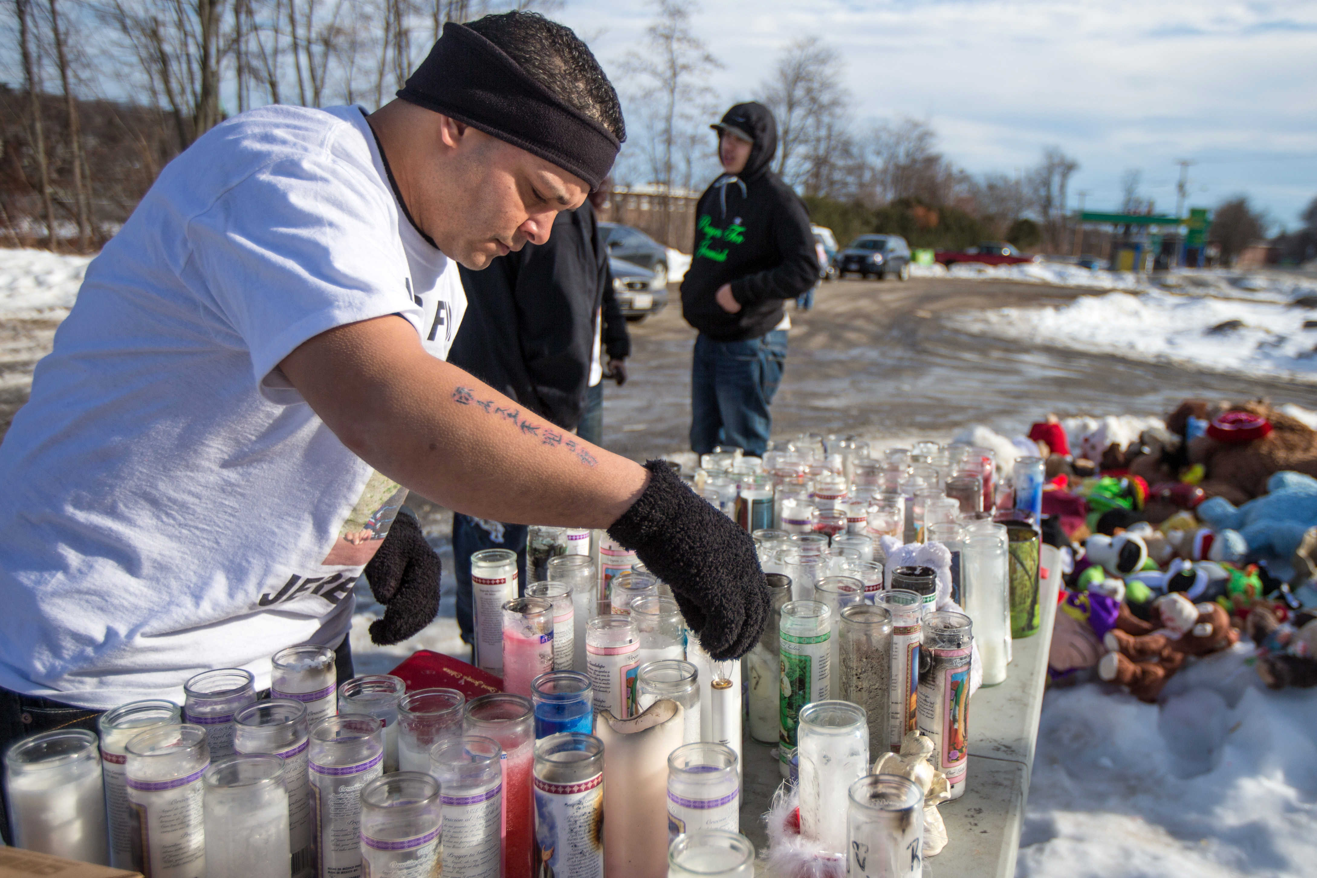 Jose Oliver visited a memorial of toys and candles set up in front of 276 Kimball Street in Fitchburg after the disappearance of his son, Jeremiah Oliver.
