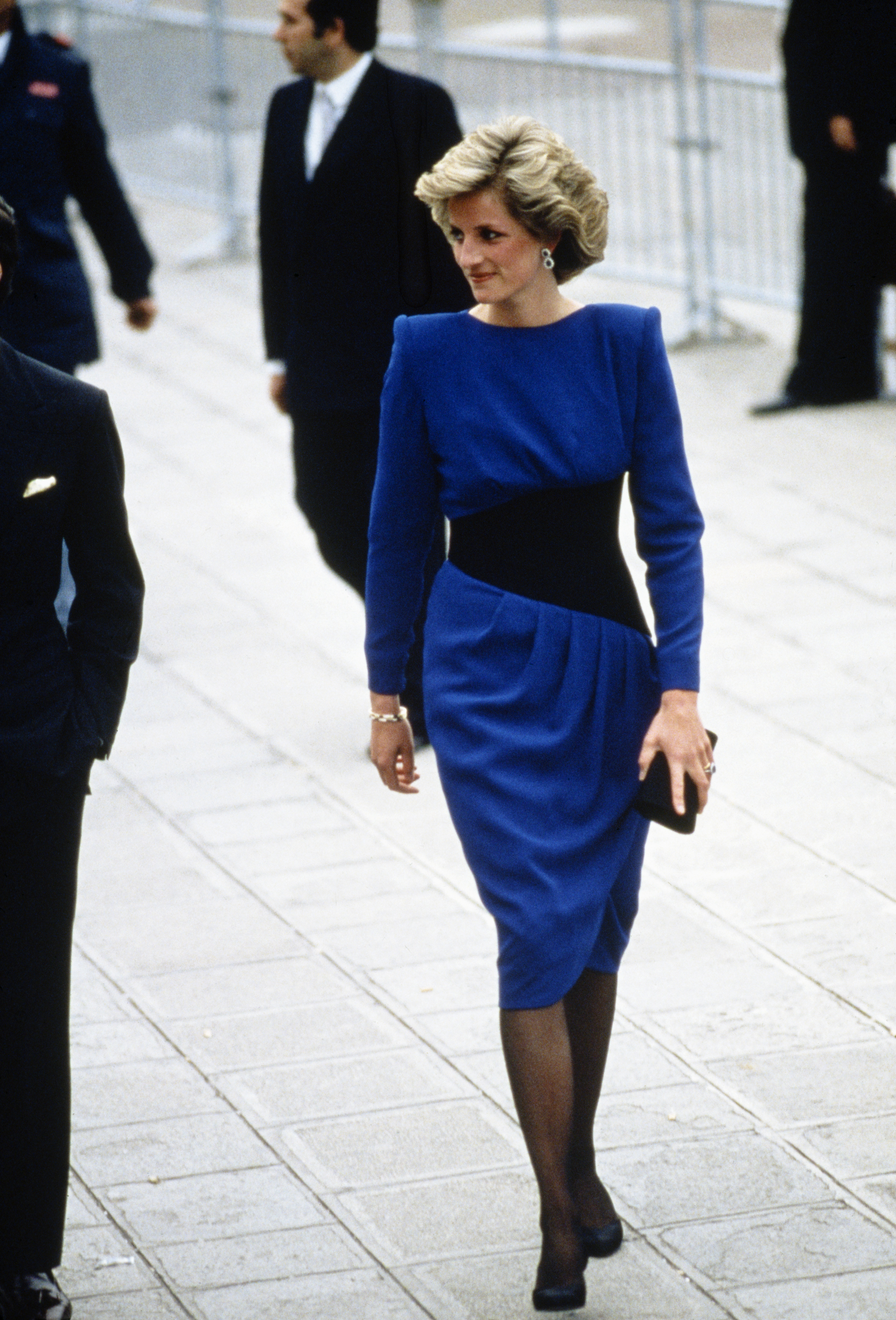 As Diana became more comfortable with her role as the princess, she took more style risks, like this angular, shoulder pad-adorned blue Bruce Oldfield dress with a nipped-in waist that she wore in Venice in May 1985.