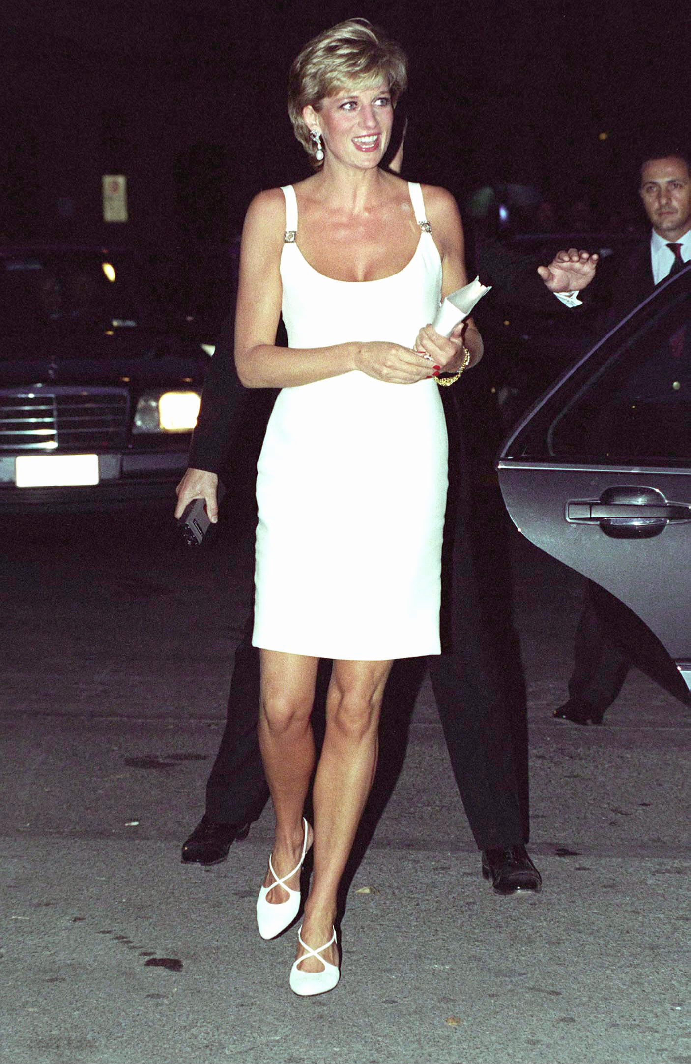 While the princess was a strong supporter of British fashion, she also loved glamorous international design houses; here, at a 1995 concert in Italy, she wears a white dress from Versace.