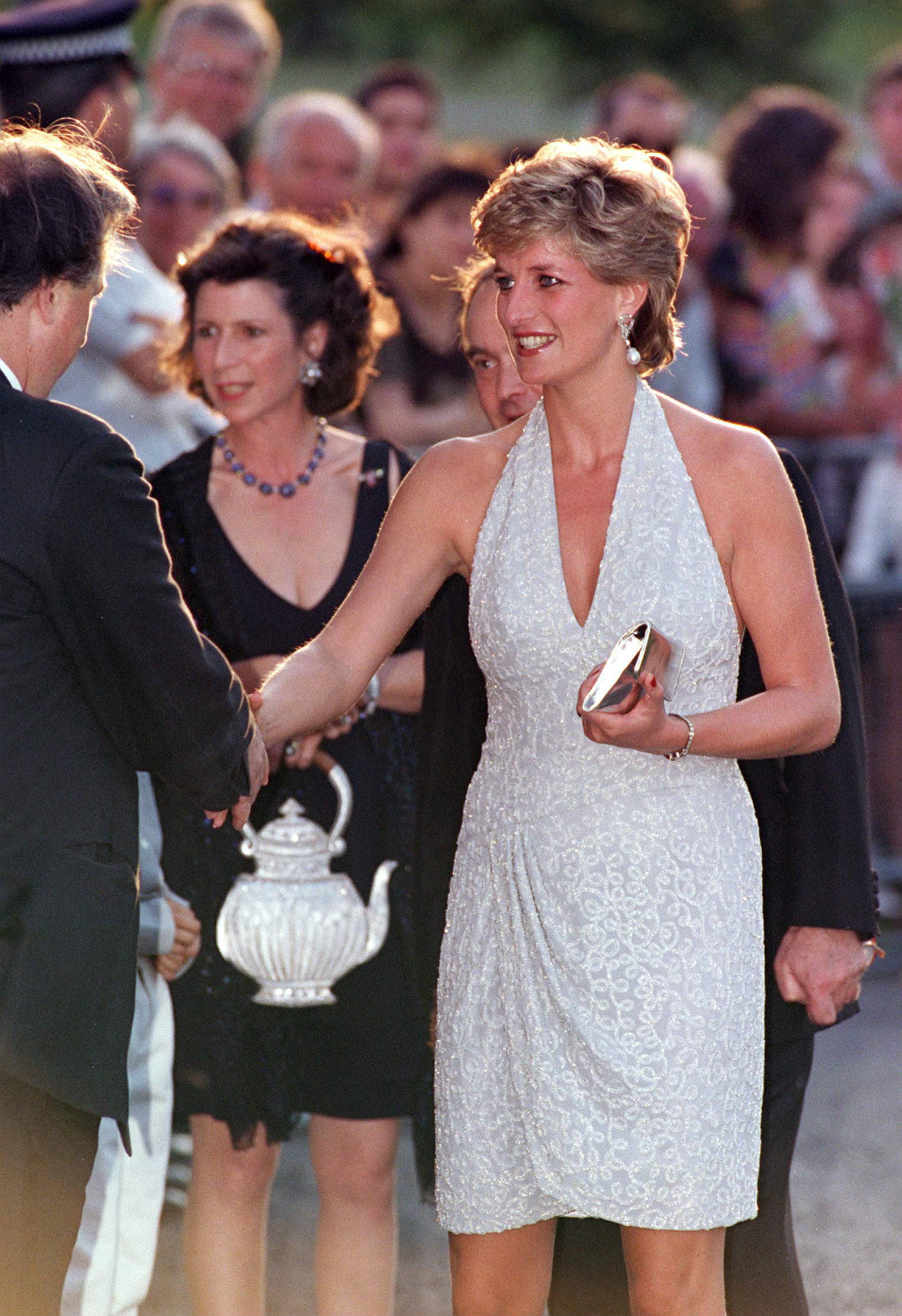 Following her separation from Prince Charles in 1992, Diana's wardrobe appeared to experience its own kind of freedom — here at a Vanity Fair party in 1995, the princess sports a short, glittery halter dress.