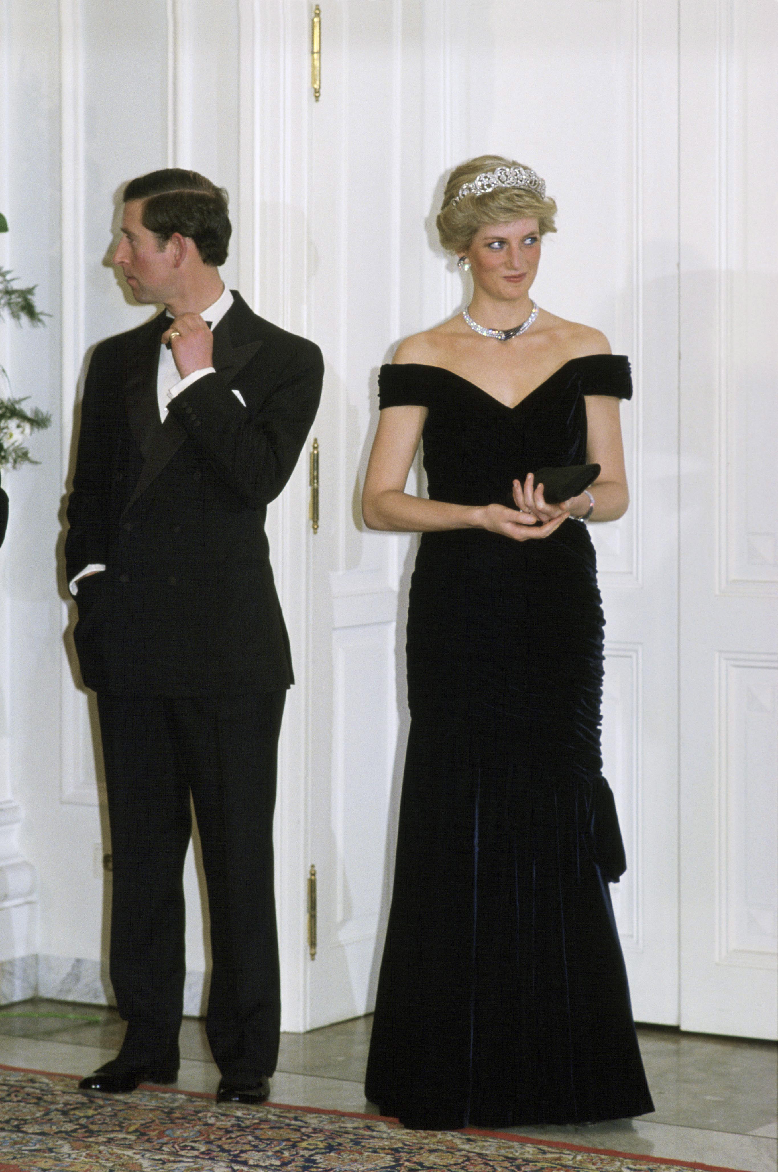 This black velvet, off-the-shoulder Victor Edelstein dress that Diana first sported at the White House in 1985 became known as the  John Travolta  dress because Diana shared a dance with him in it.
