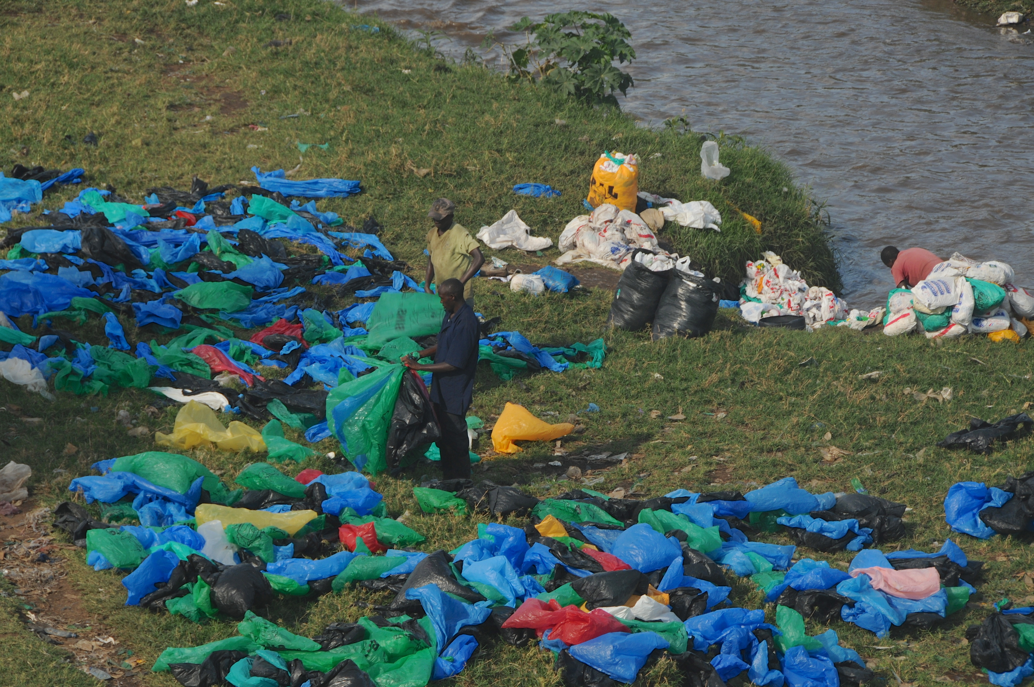 This undated photo shows Kenyans collecting used plastic bags from Nairobi River to resell in marketplaces near the Mukuru slum in Kenya.