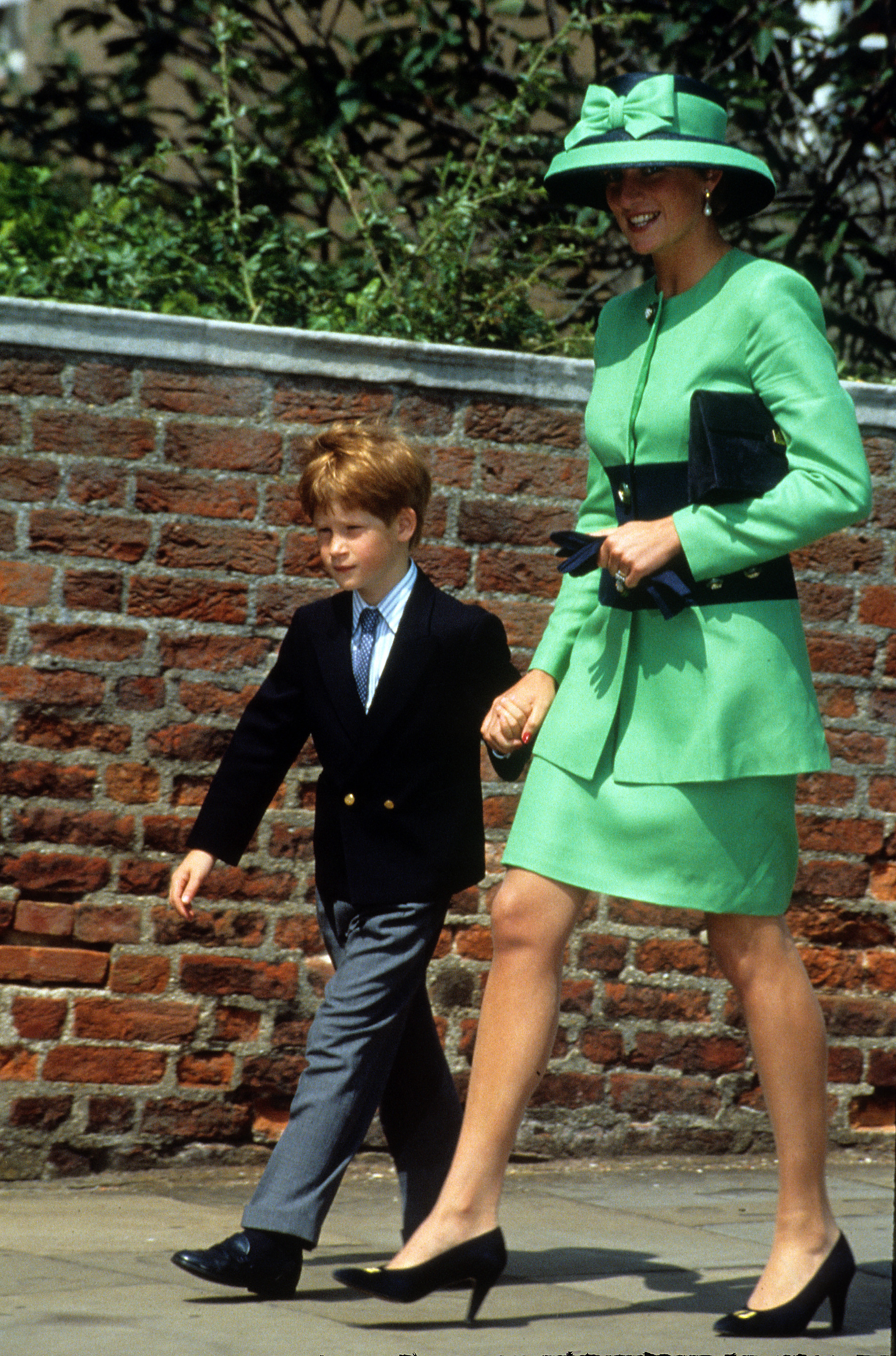 For the wedding of Lady Helen Windsor to Tim Taylor in 1992, Diana wore a bright green suit and a matching hat.