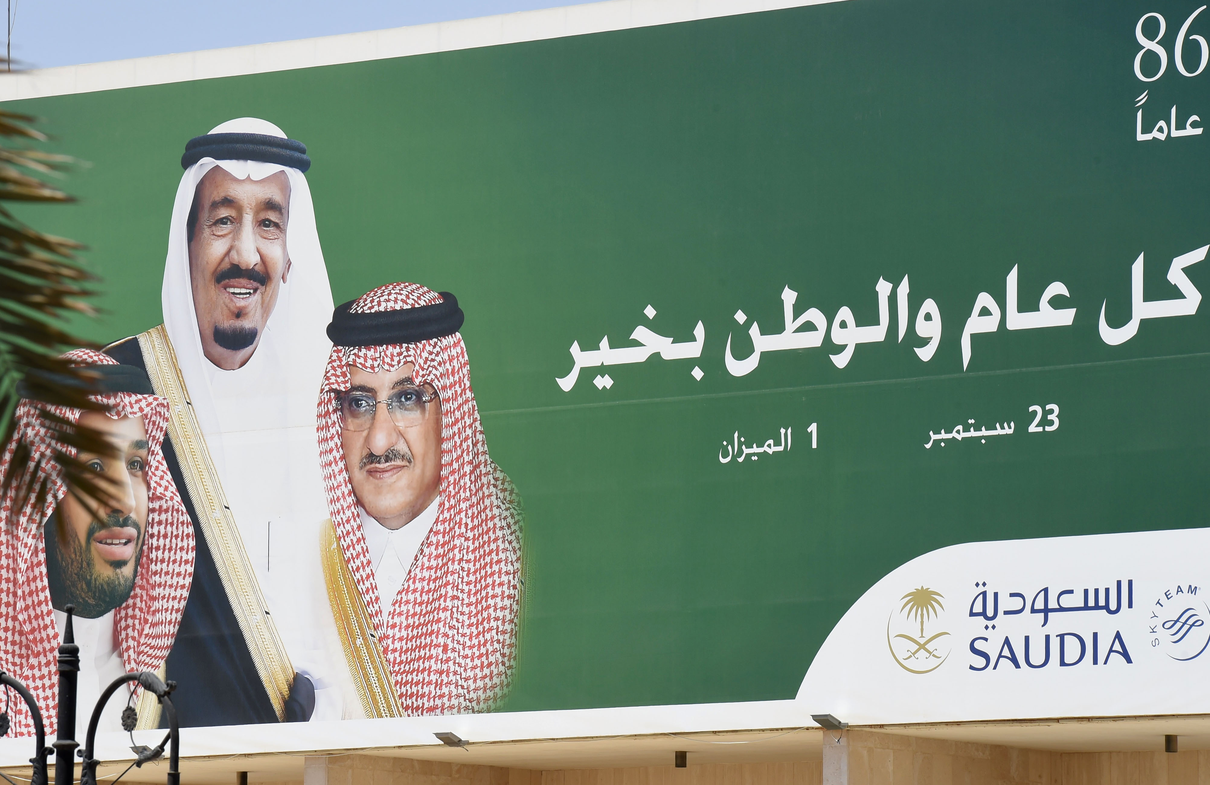 A picture taken on June 6, 2017 shows a poster of Saudi King Salman (C), former Crown Prince and Interior Minister Mohammed bin Nayef (R) and new Crown Prince Mohammed bin Salman