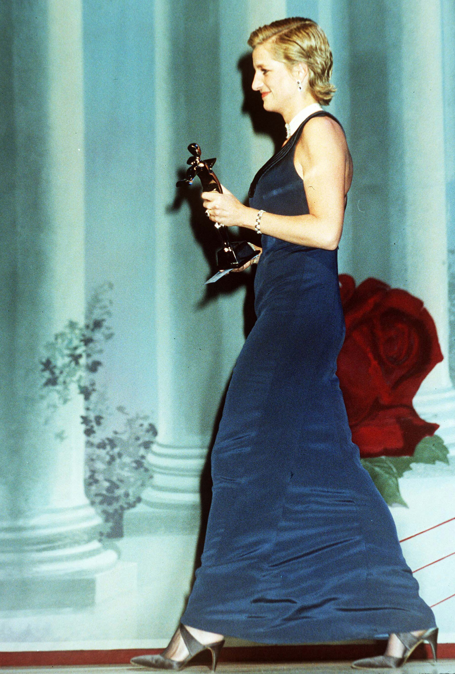To honor her favorite designer Catherine Walker at a fashion awards ceremony in NYC, Diana wore a sleek navy gown of Walker's design.