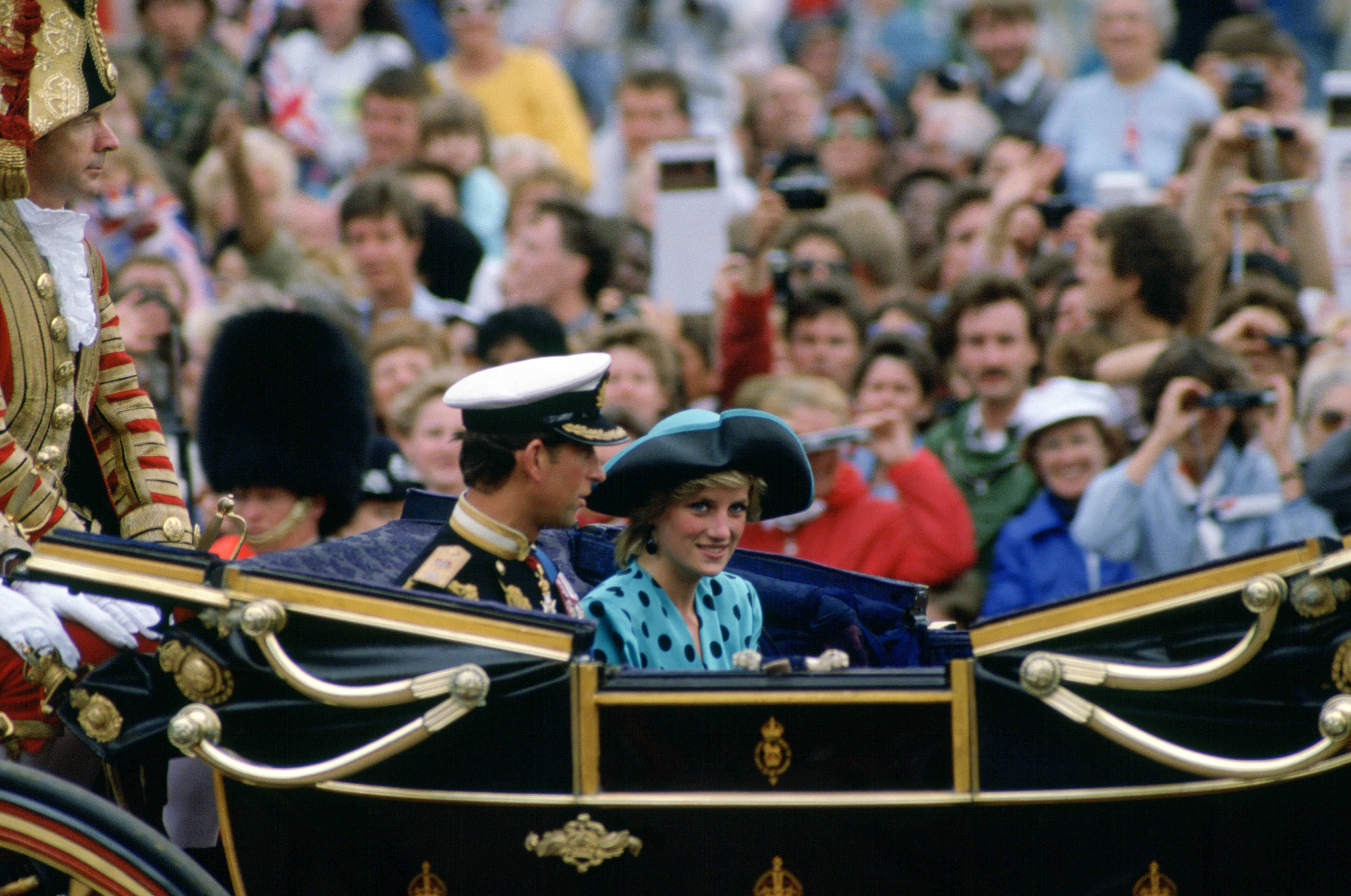 For the wedding of Prince Andrew and Sarah Ferguson, Princess Di wore a turquoise polka dotted suit and matching hat.
