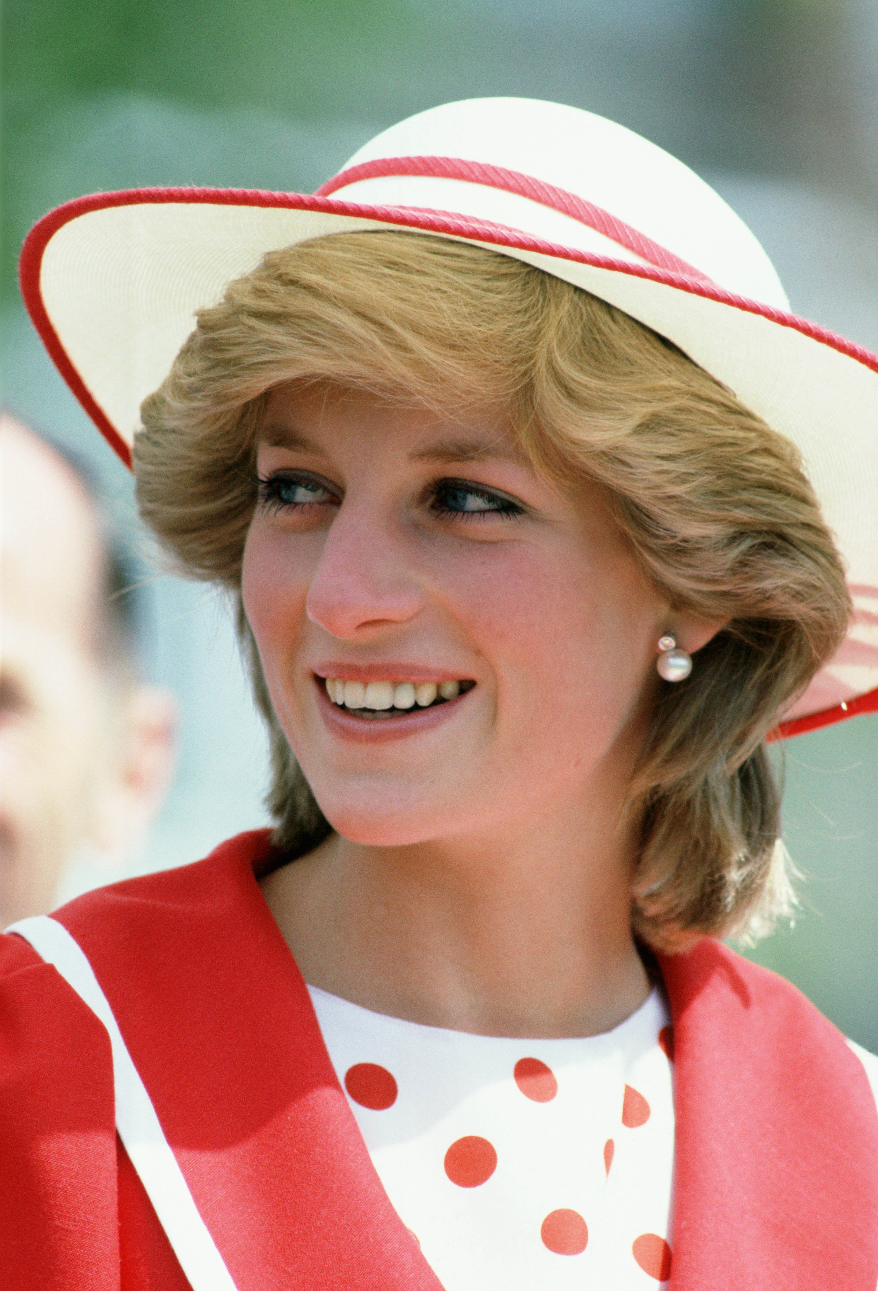 Call it sartorial diplomacy, but Diana usually sported red and white ensembles during royal trips to Canada; here, she wore a coordinating hat and red and white polka dot suit in June 1983.