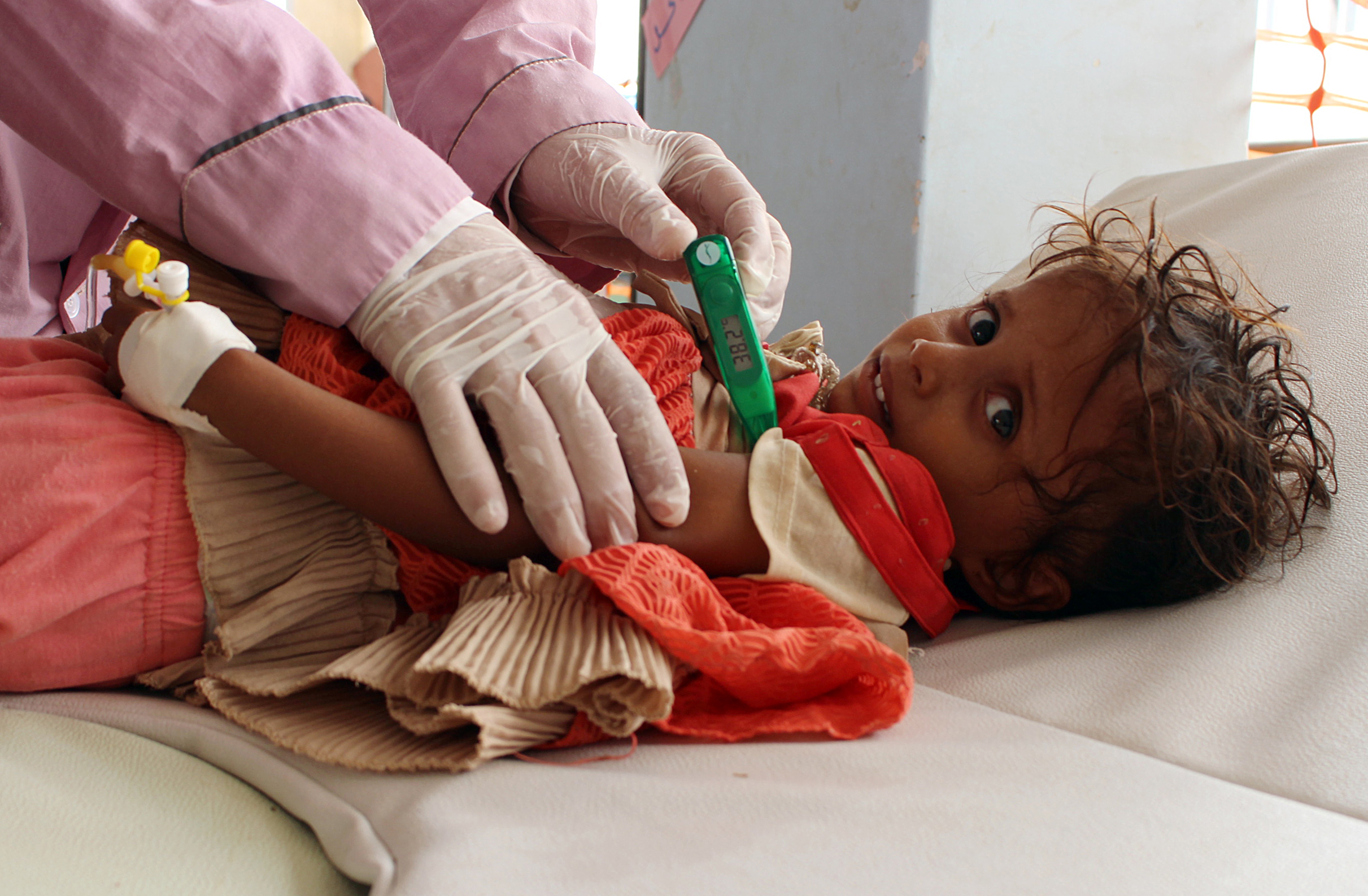 A Yemeni child suspected of being infected with cholera is checked by a doctor at a makeshift hospital operated by Doctors Without Borders in Yemen's Hajjah province on July 16, 2017.