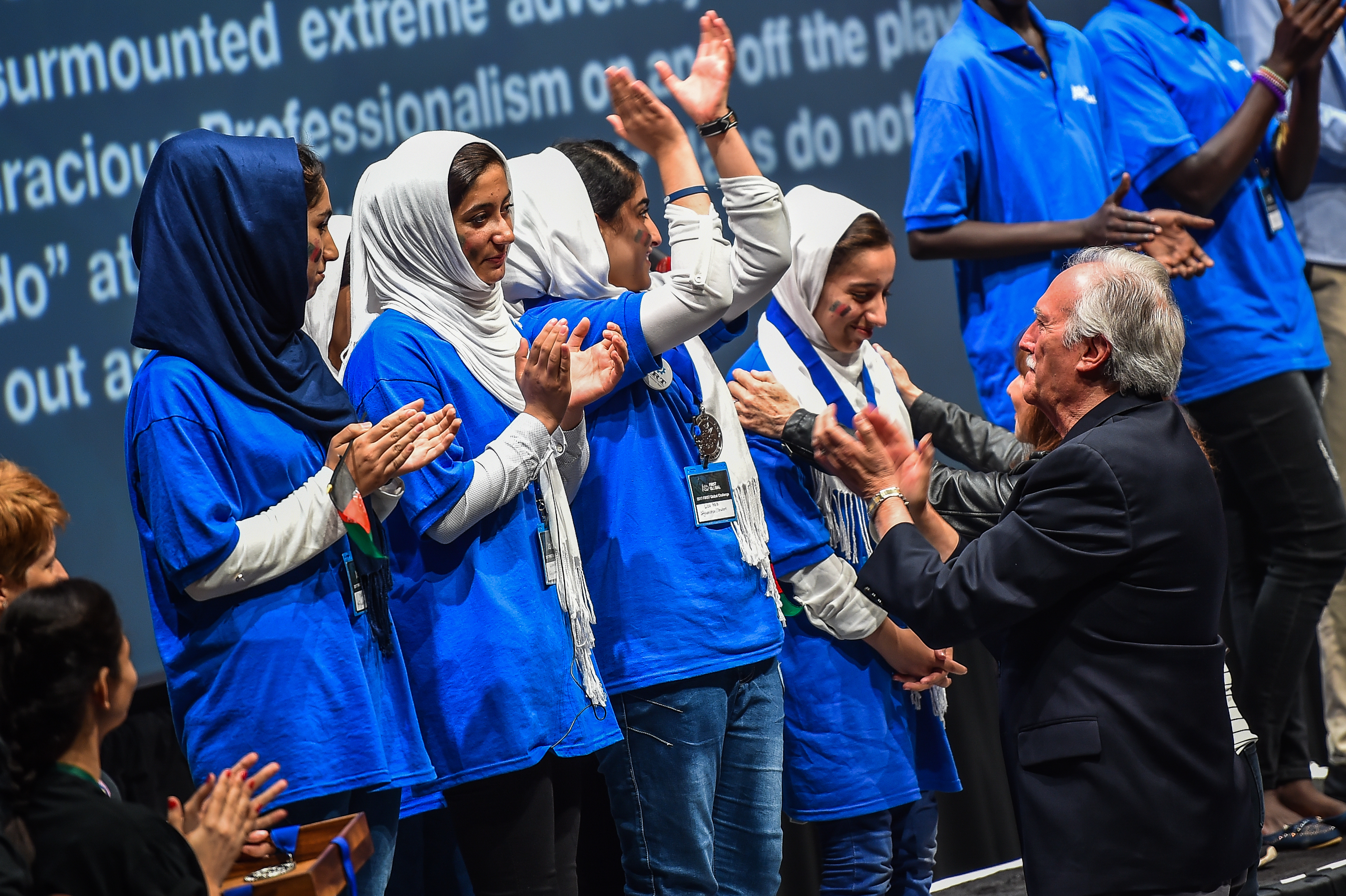 Team Afghanistan cheer after receiving silver for Rajaa Cherkaoui El Moursli Award for Courageous Achievement during the FIRST Global Challenge, international annual robotics game awards ceremony on Tuesday, July 18, 2017, at the DAR Constitution Hall in Washington, D.C.